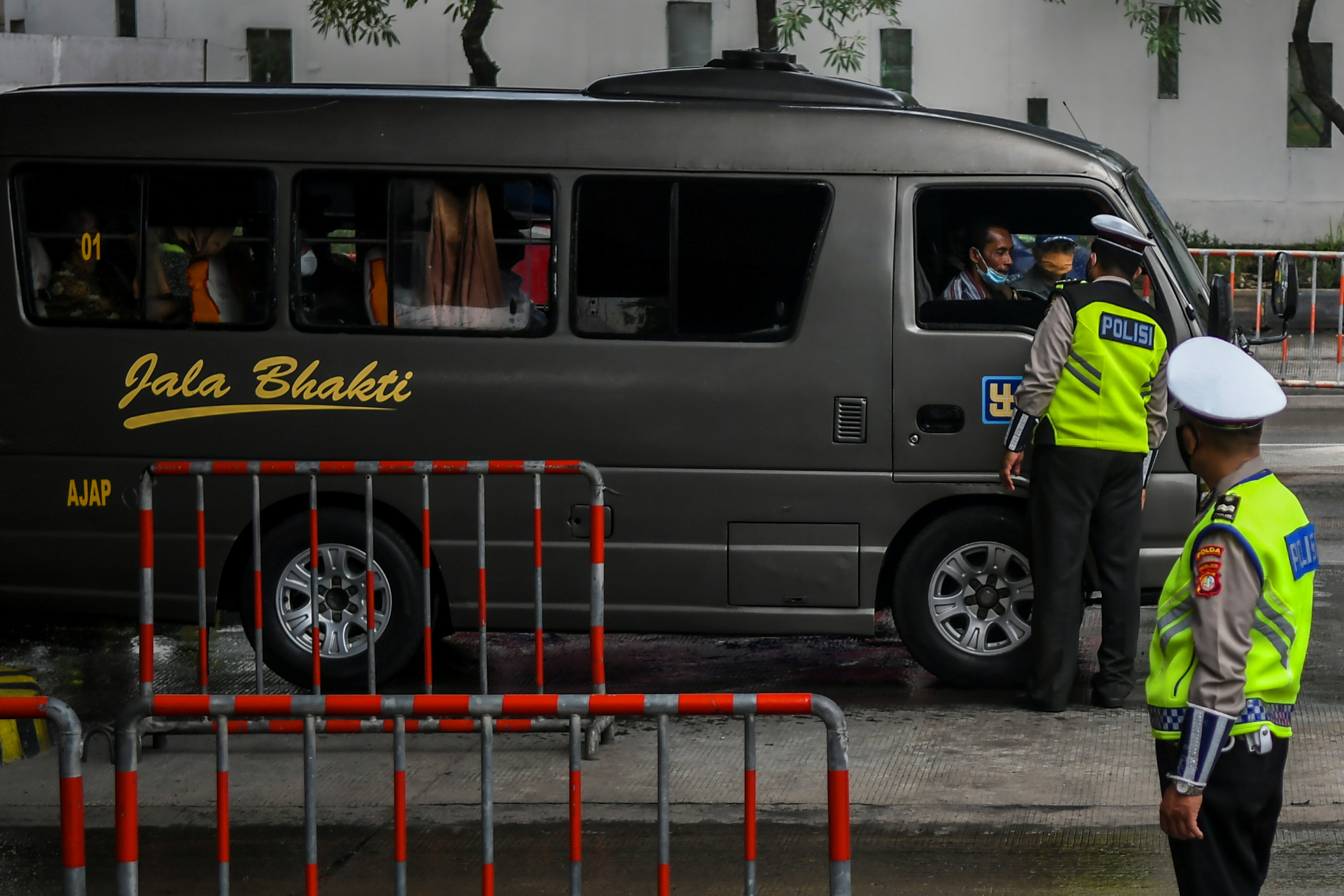 Police officers inspect a bus on the first day of a national travel ban as Indonesia halts sea, land, air, and rail travel for the Eid al-Fitr celebrations in an effort to prevent a large-scale transmission of the coronavirus disease (COVID-19) pandemic in Banten Province, Indonesia May 6, 2021, in this photo taken by Antara Foto/Galih Pradipta/via Reuters.