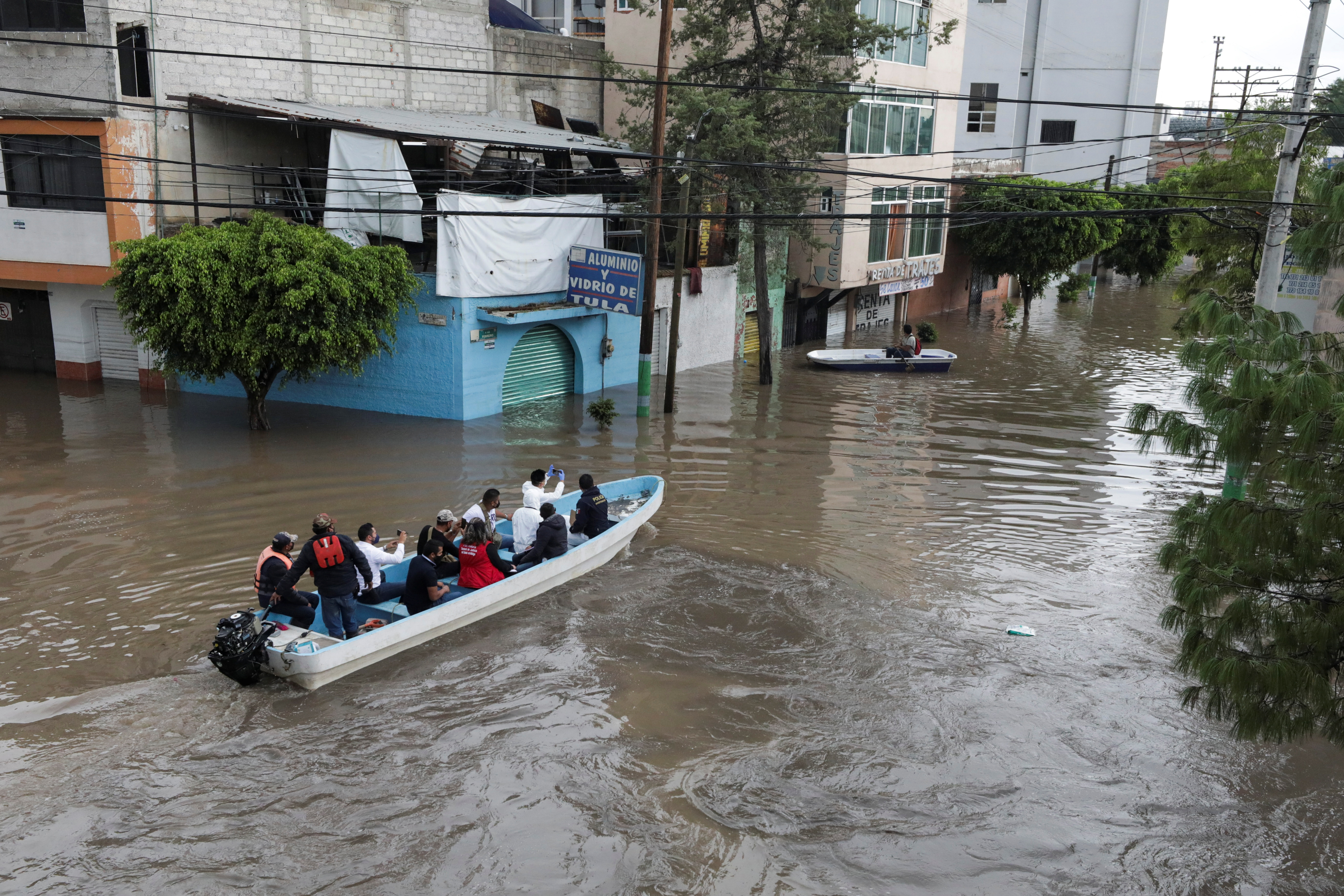 Rescue teams evacuate residents in a boat through flooded streets after heavy rainfall during Monday's night in the municipality of Tula de Allende, which left people dead, injured and cars and infrastructure damaged, in Tula de Allende, on the outskirts of Mexico City, Mexico September 7, 2021. REUTERS/Henry Romero
