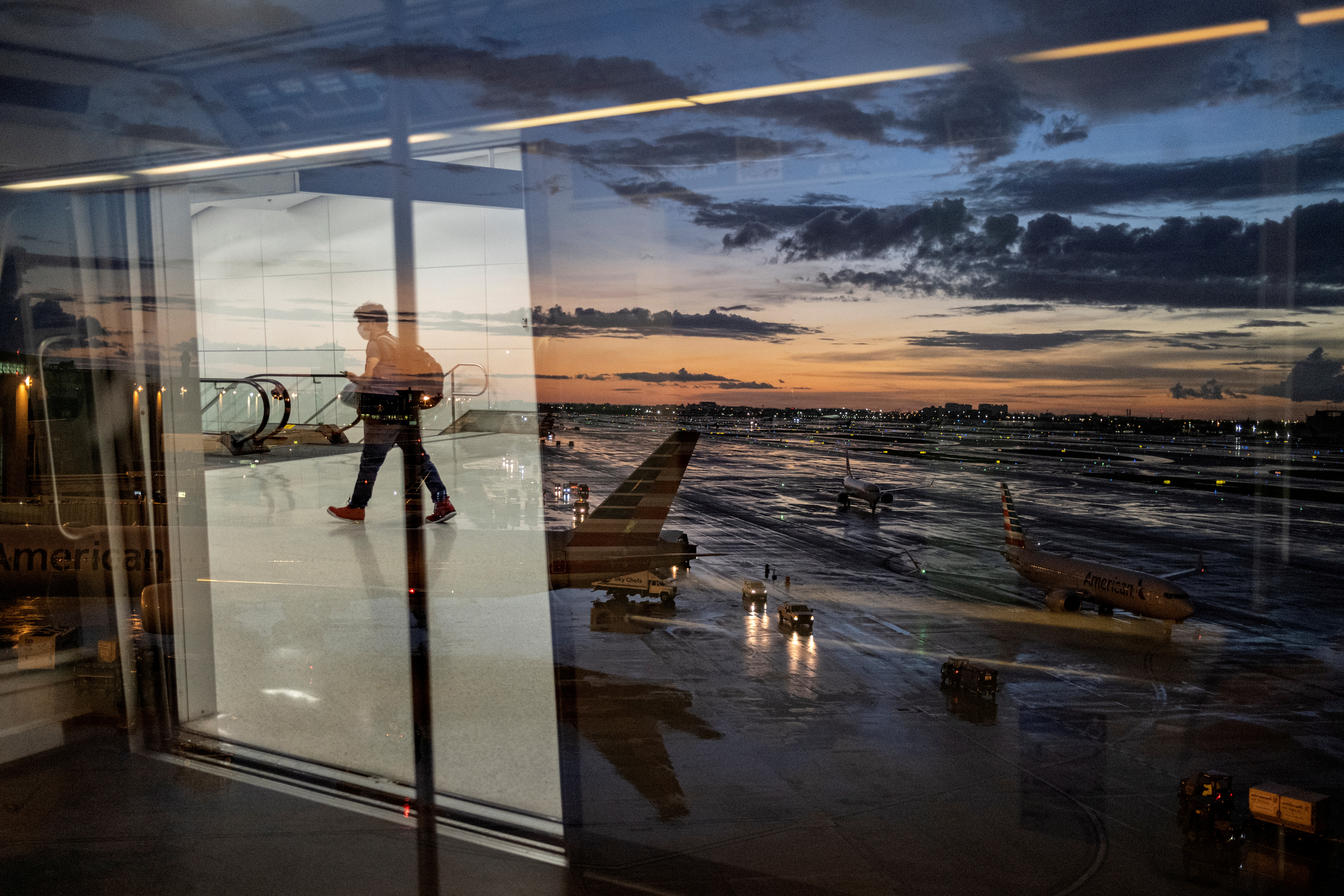 A passenger arrives at terminal D of Miami International Airport after heavy rains, as Hurricane Elsa moves towards south Florida, in Miami, U.S. July 2, 2021. Picture taken July 2, 2021. REUTERS/Carlos Barria