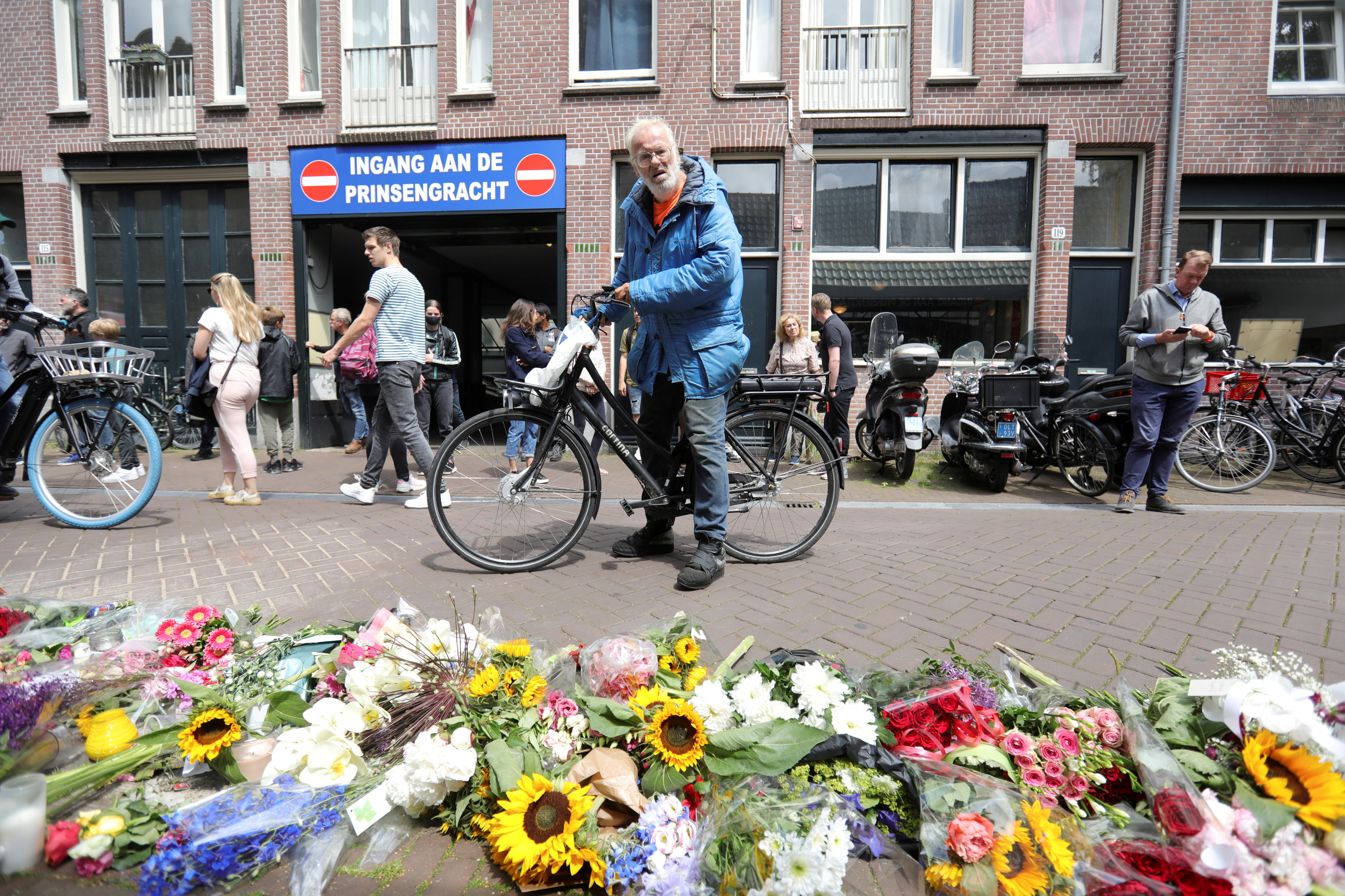 A man looks on next to a makeshift altar at the place where Dutch celebrity crime reporter Peter R. de Vries has been shot and reported seriously injured in Amsterdam, Netherlands, July 7, 2021. REUTERS/Eva Plevier/File Photo