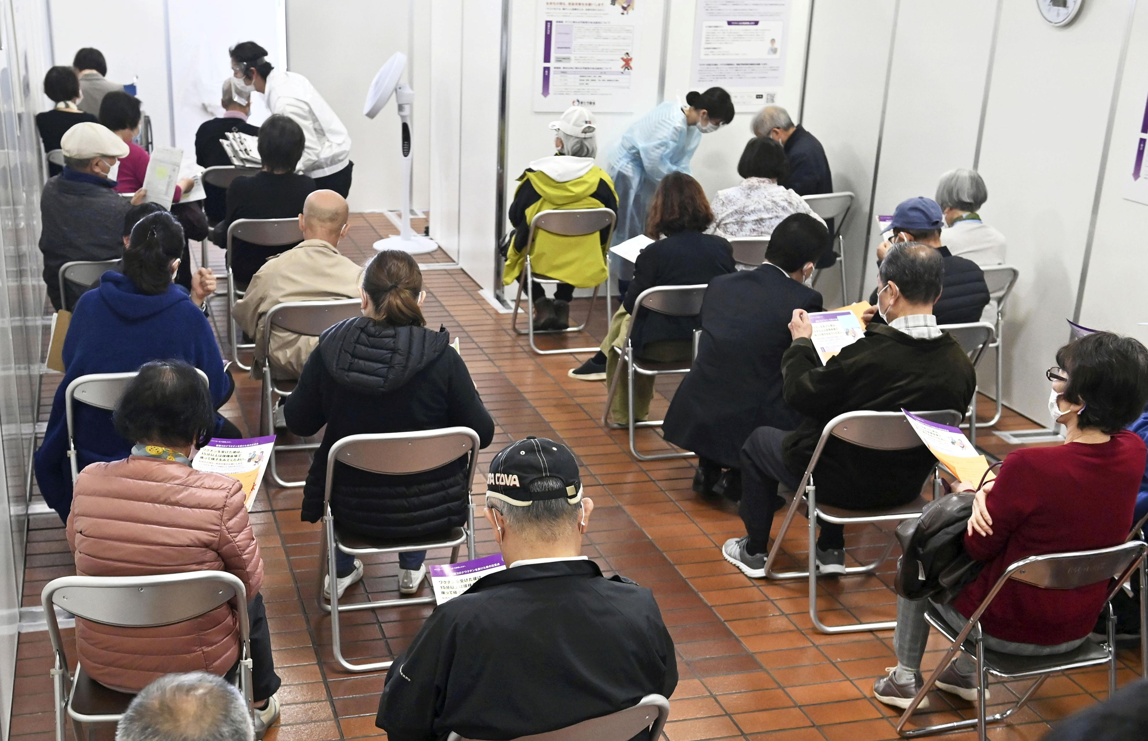 Elderly people wait in an observation room after receiving coronavirus disease (COVID-19) vaccinations in Hachioji, western Tokyo. April 12, 2021, in this photo released by Kyodo. Kyodo/via REUTERS