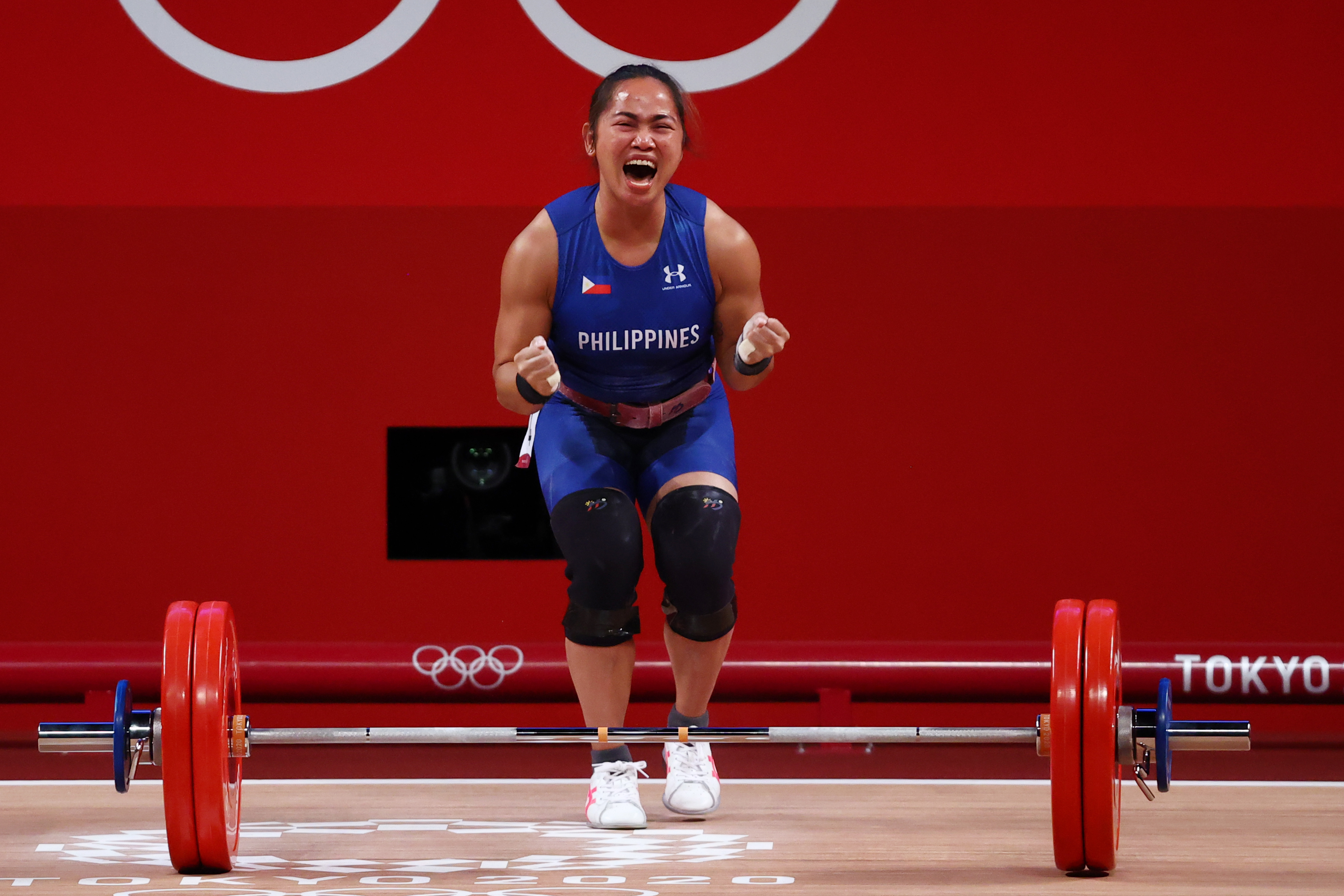 Tokyo 2020 Olympics - Weightlifting - Women's 55kg - Group A - Tokyo International Forum, Tokyo, Japan - July 26, 2021. Hidilyn Diaz of the Philippines celebrates after a lift. REUTERS/Edgard Garrido