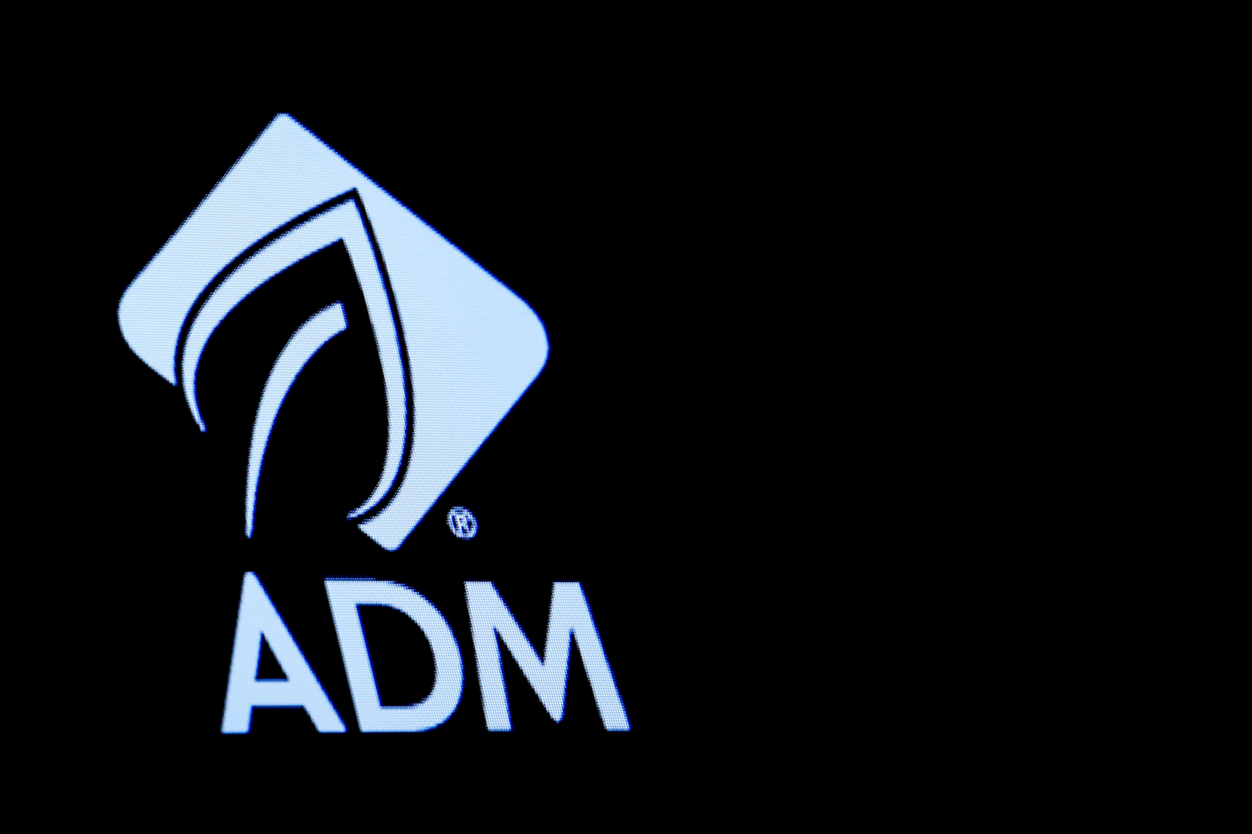 The Archer Daniels Midland Co. (ADM) logo is displayed on a screen on the floor of the New York Stock Exchange (NYSE) in New York, U.S., May 3, 2018. REUTERS/Brendan McDermid/File Photo