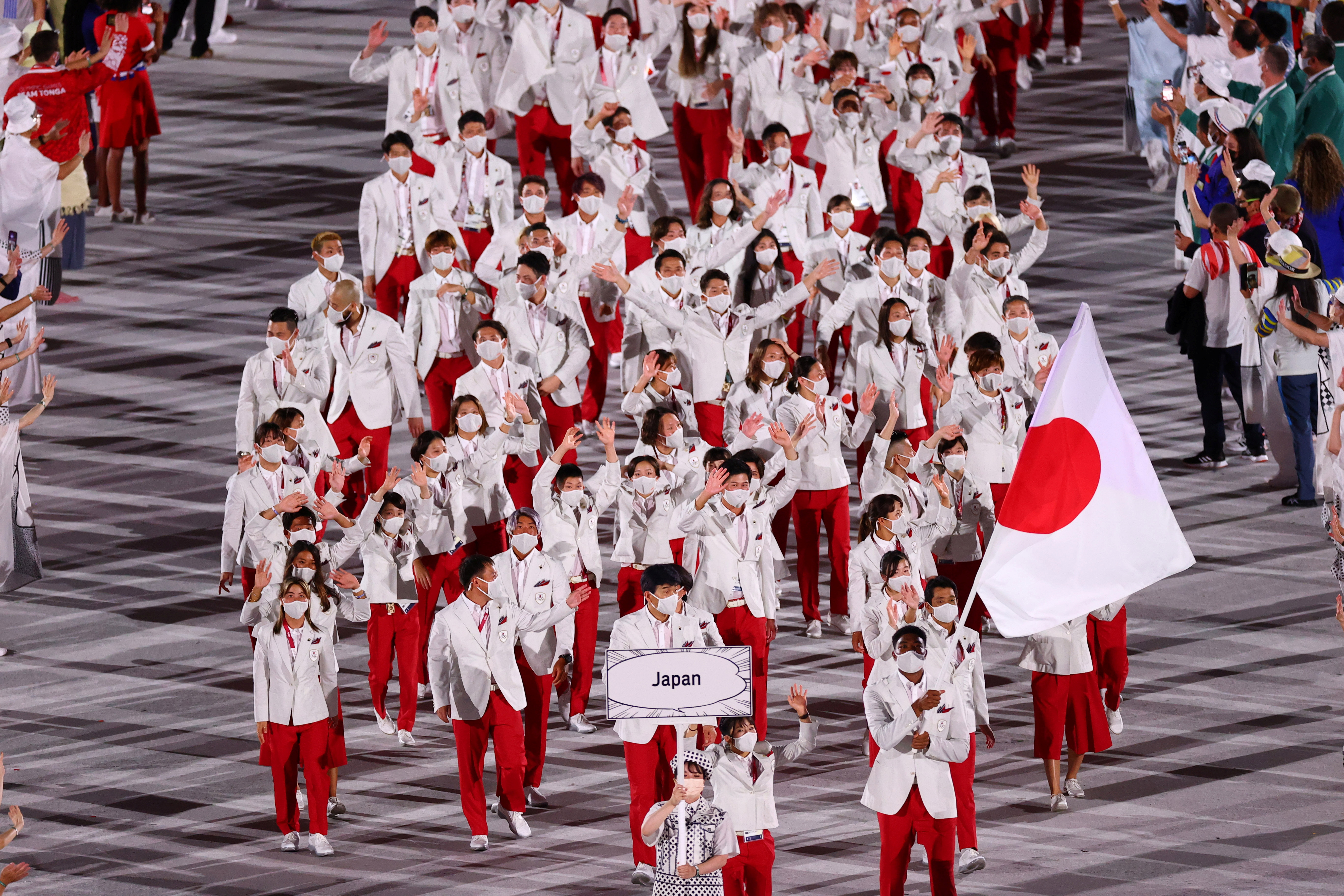 Tokyo 2020 Olympics - The Tokyo 2020 Olympics Opening Ceremony - Olympic Stadium, Tokyo, Japan - July 23, 2021. Flag bearers Yui Susaki of Japan and Rui Hachimura of Japan lead their contingent during the athletes parade at the opening ceremony REUTERS/Mike Blake/File Photo