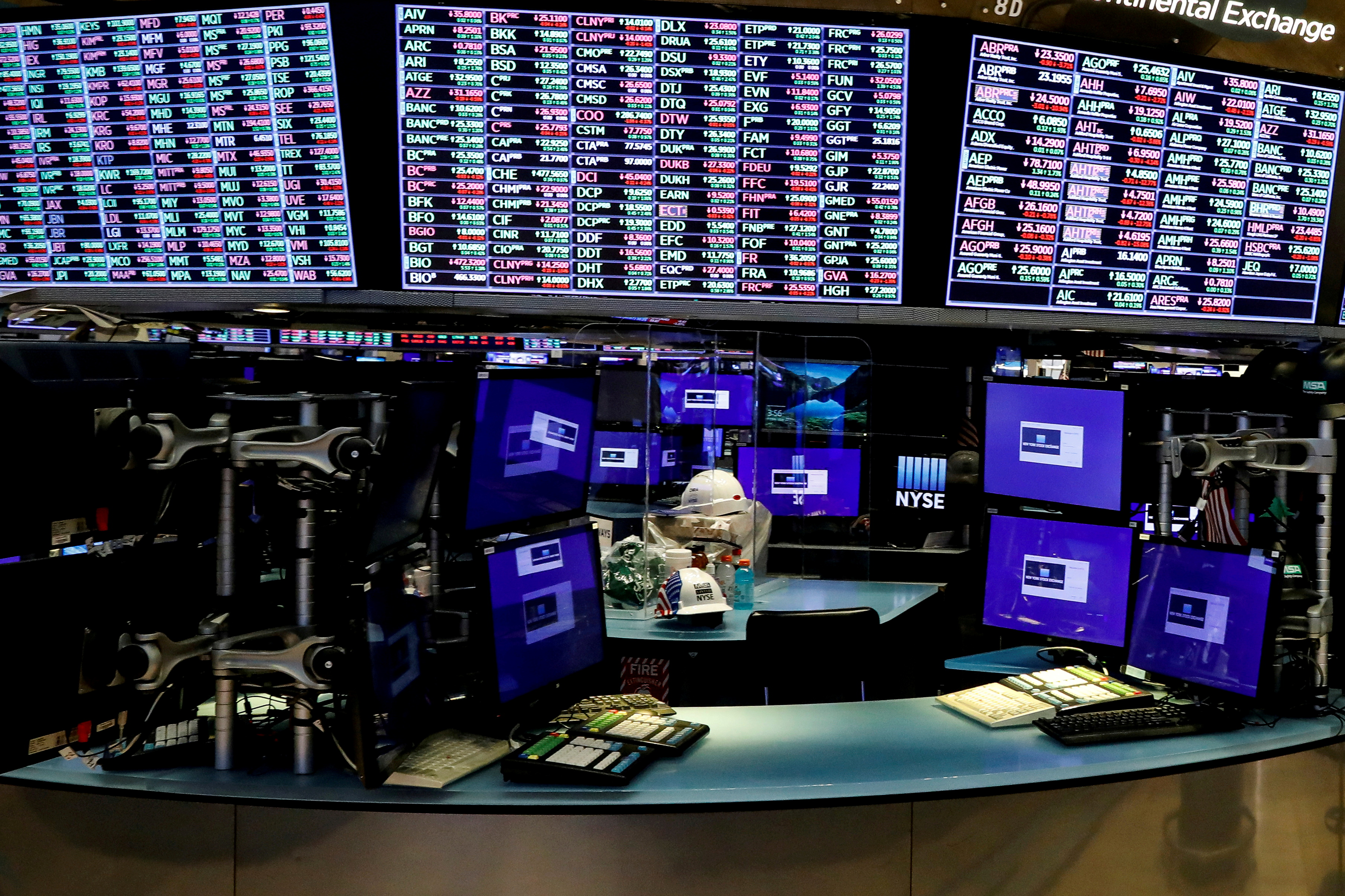 Dividers are seen inside a trading post on the trading floor as preparations are made for the return to trading at the New York Stock Exchange (NYSE), May 22, 2020. REUTERS/Brendan McDermid/File Photo