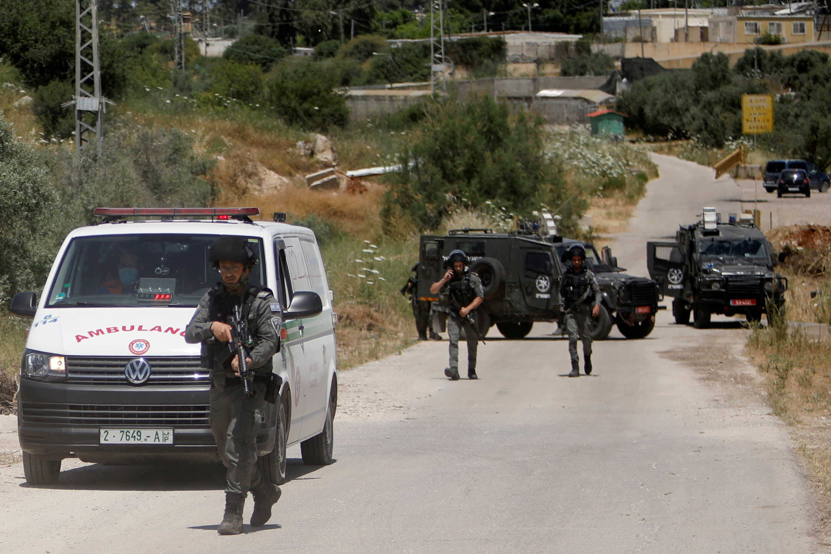 Members of Israeli border police patrol near the scene of a security incident at an Israeli military base near Jenin in the Israeli-occupied West Bank, May 7, 2021. REUTERS/Raneen Sawafta