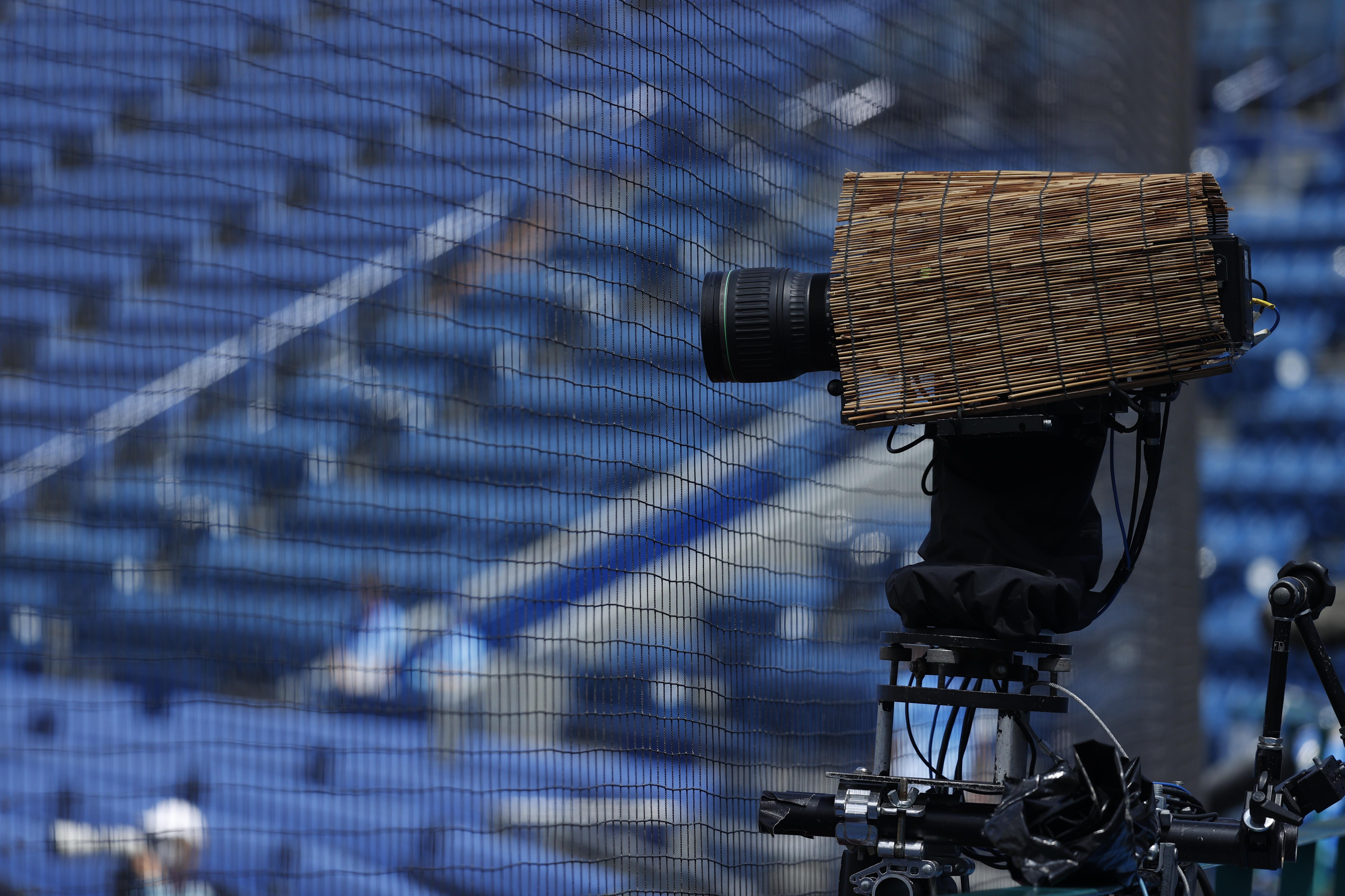 Aug 4, 2021; Yokohama, Japan; A camera is shielded from the heat by a straw cover in a baseball repechage contest between Dominican Republic and USA during the Tokyo 2020 Olympic Summer Games at Yokohama Baseball Stadium. Mandatory Credit: Yukihito Taguchi-USA TODAY Sports