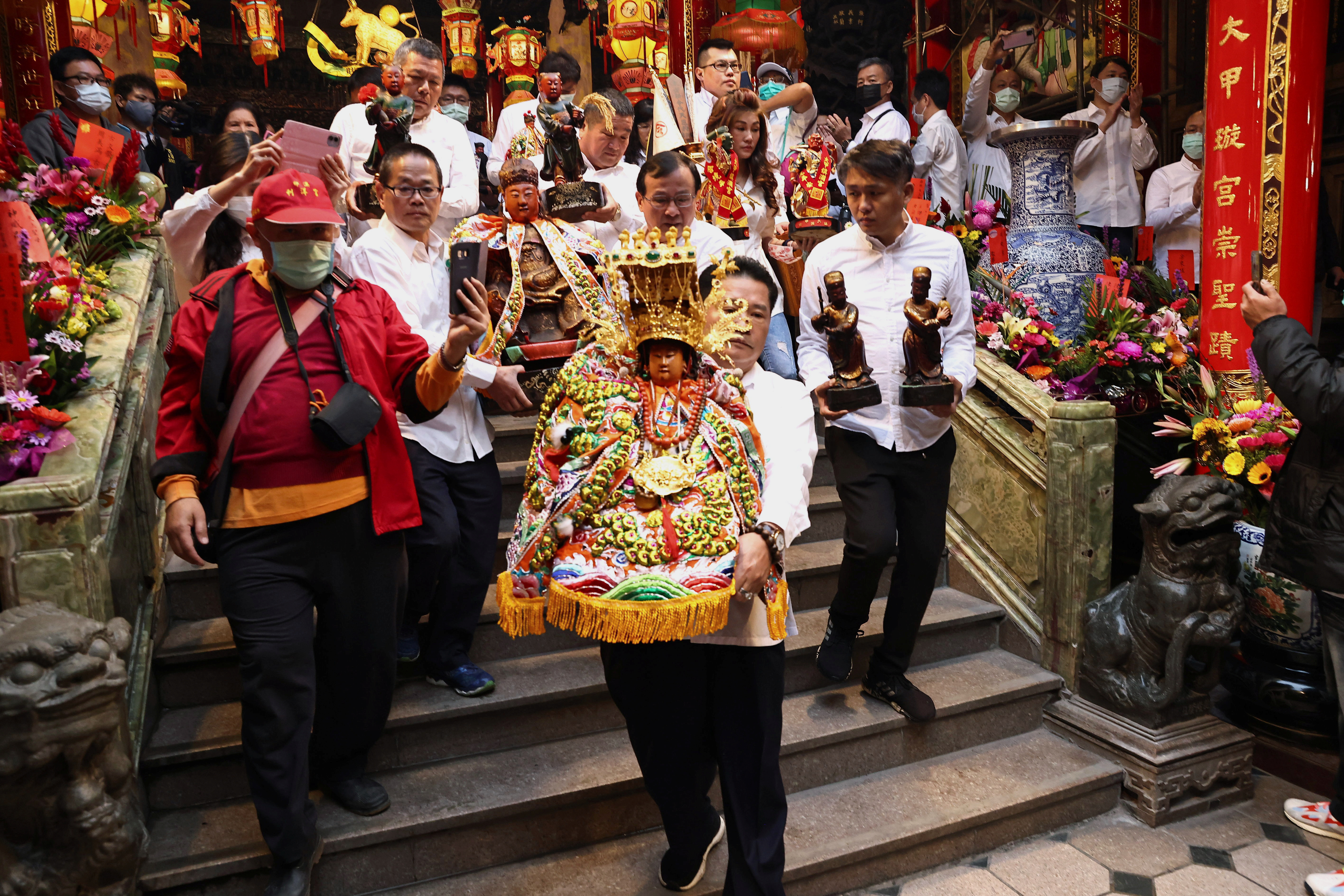 Yen Ching-piao, chairman of the Jenn Lann Temple, carries a statue of the sea goddess Mazu to begin the rain prayer ritual at the temple, in Taichung, Taiwan March 7, 2021. REUTERS/Ann Wang