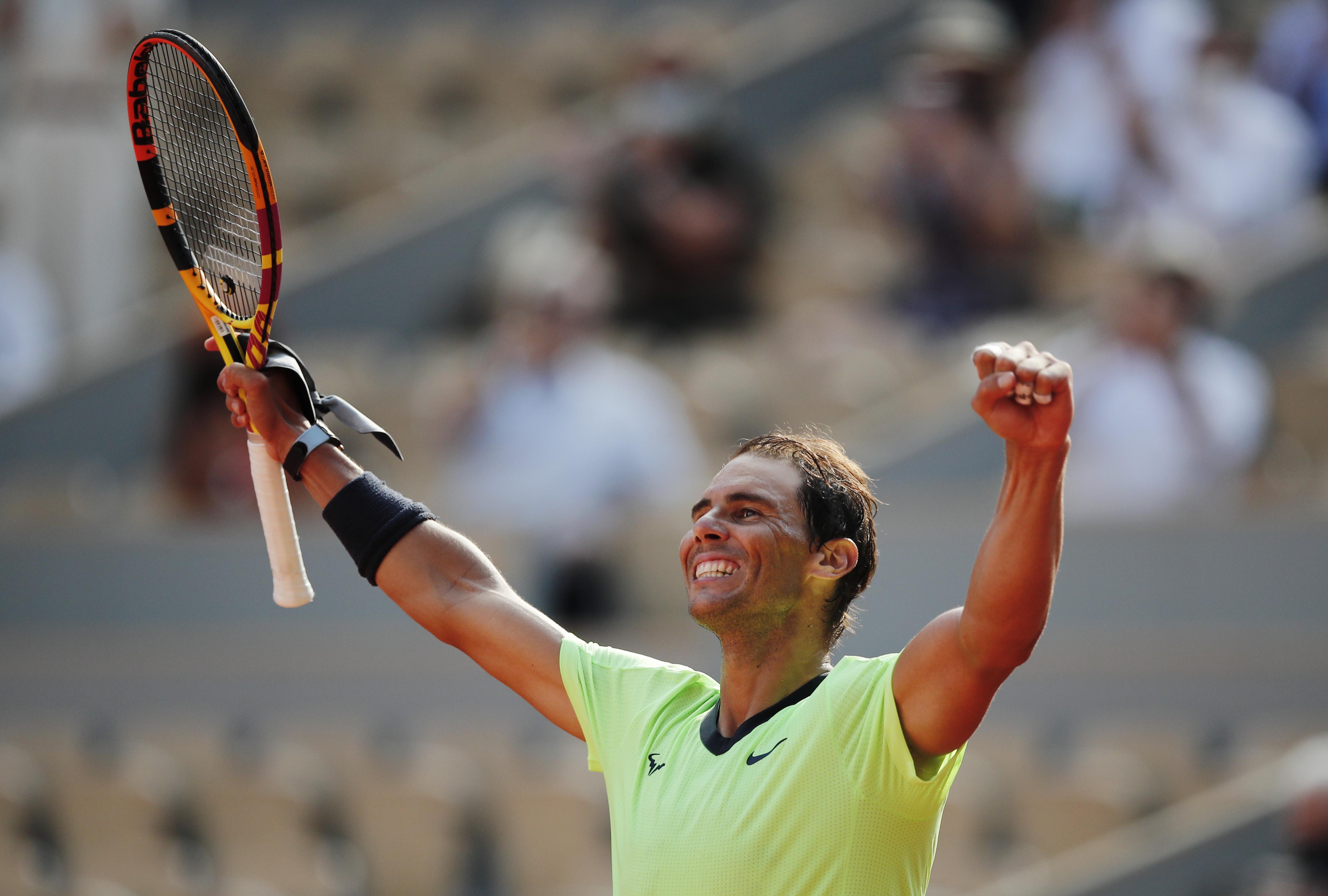 Tennis - French Open - Roland Garros, Paris, France - June 9, 2021  Spain's Rafael Nadal celebrates winning his quarter final match against Argentina's Diego Schwartzman REUTERS/Benoit Tessier