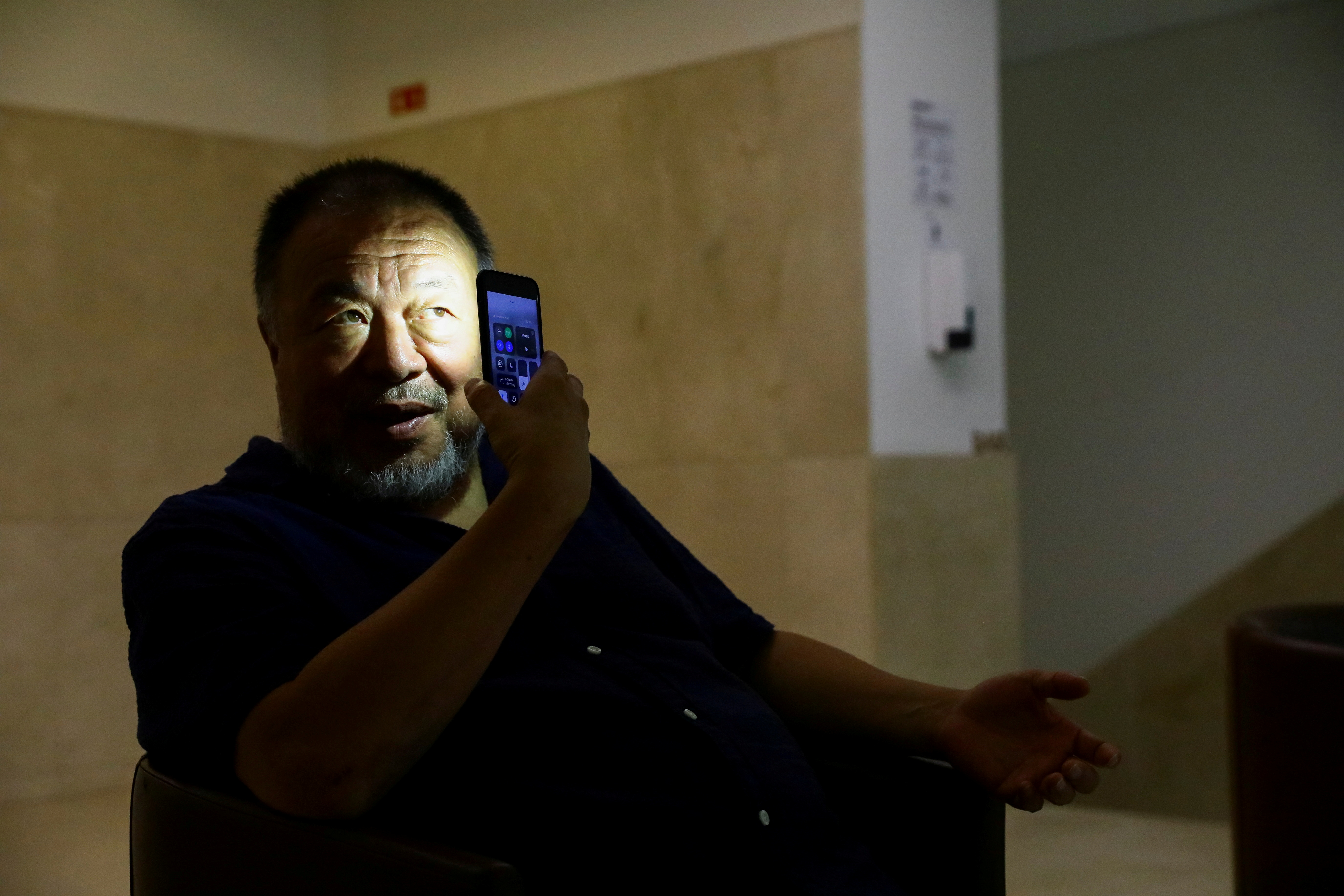 Chinese artist Ai Weiwei poses for a portrait during a presentation of his new exhibition