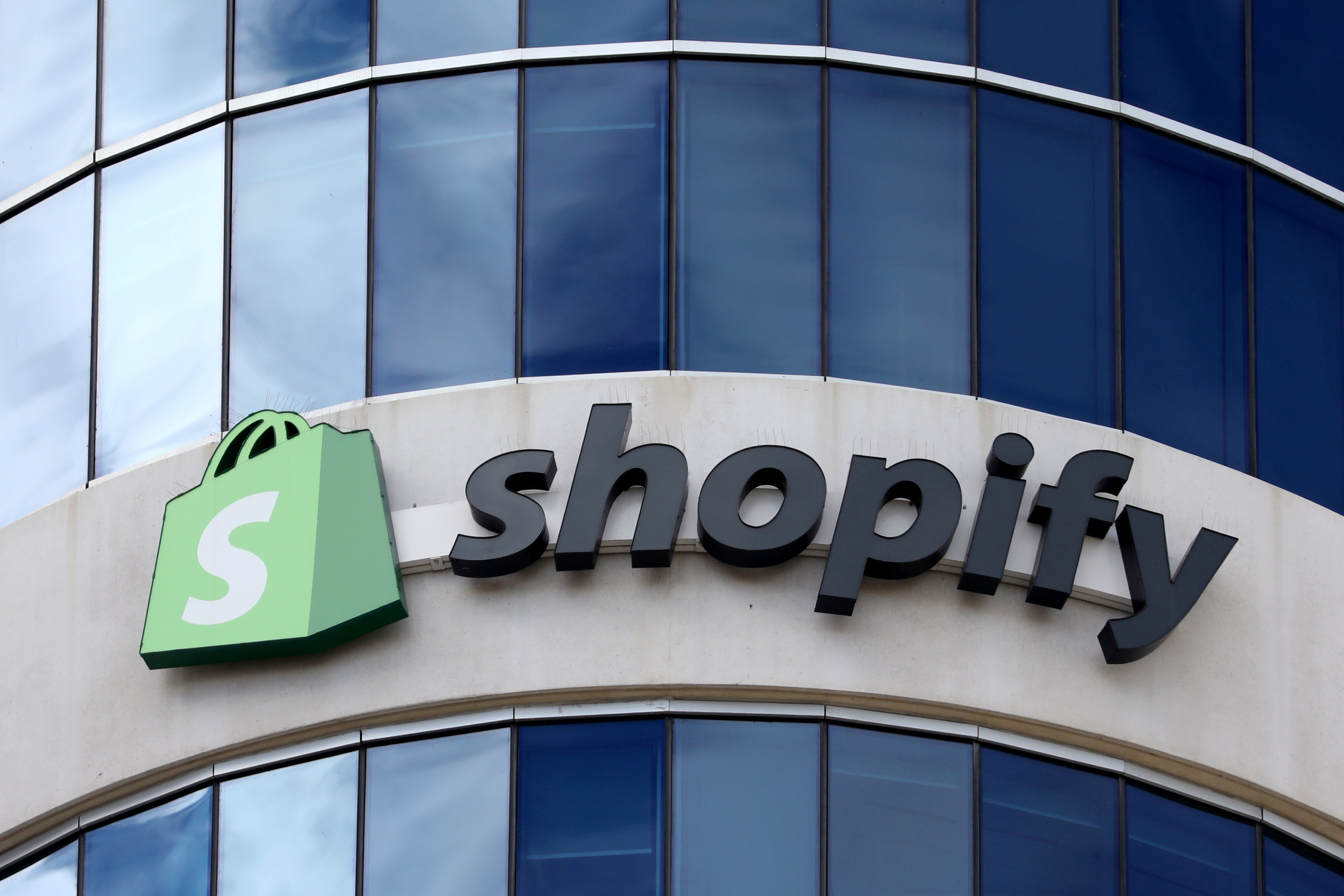 The logo of Shopify is seen outside its headquarters in Ottawa, Ontario, Canada, September 28, 2018. REUTERS/Chris Wattie/File Photo  GLOBAL BUSINESS WEEK AHEAD