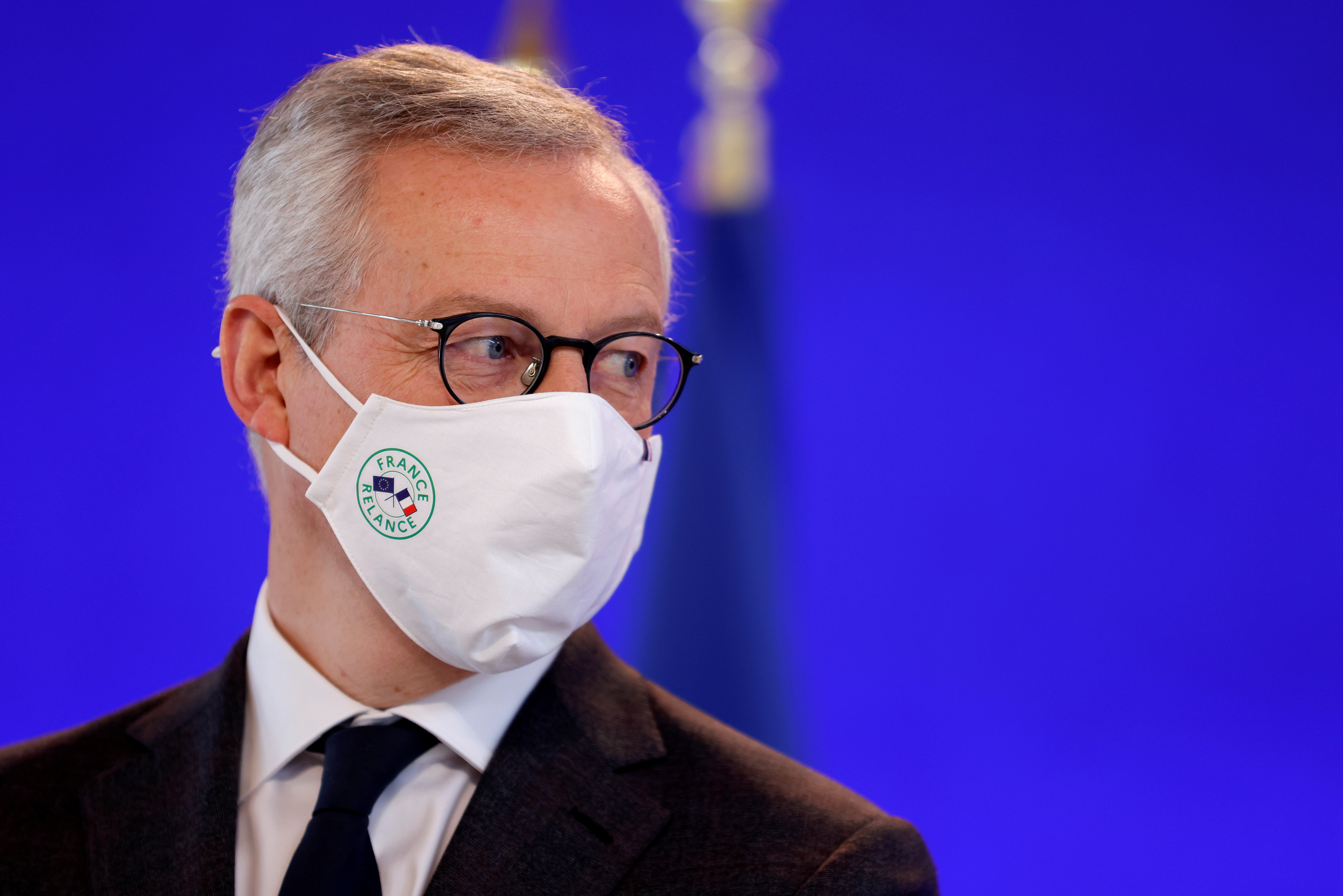 French Economy and Finance Minister Bruno Le Maire, wearing a protective face mask, attends a video conference at the Bercy Finance Ministry in Paris, France, February 15, 2021. REUTERS/Sarah Meyssonnier/File Photo