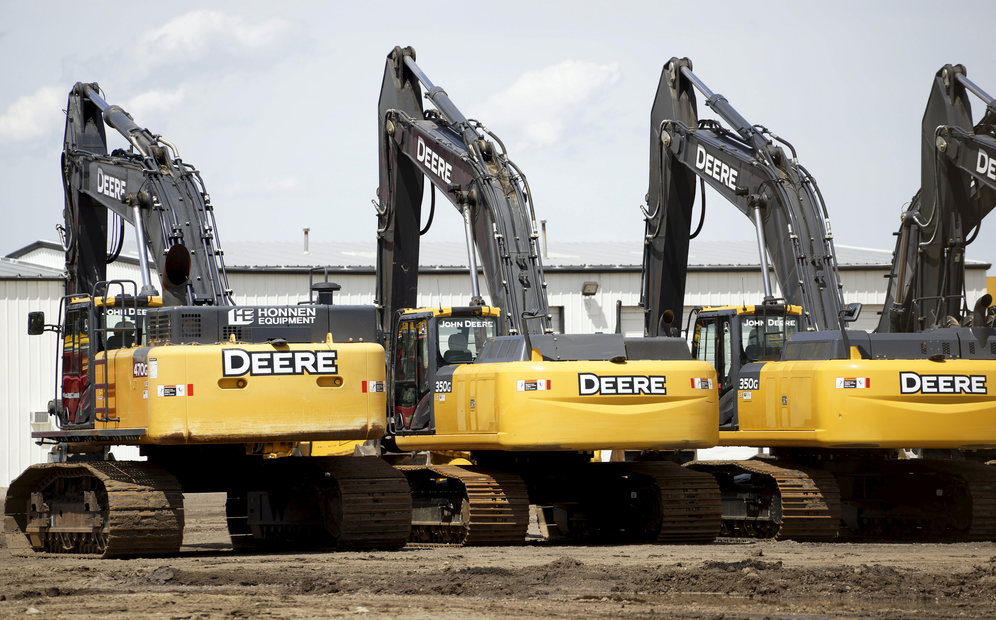 Equipment for sale is seen at a John Deere dealer in Denver May 14, 2015. REUTERS/Rick Wilking/File Photo