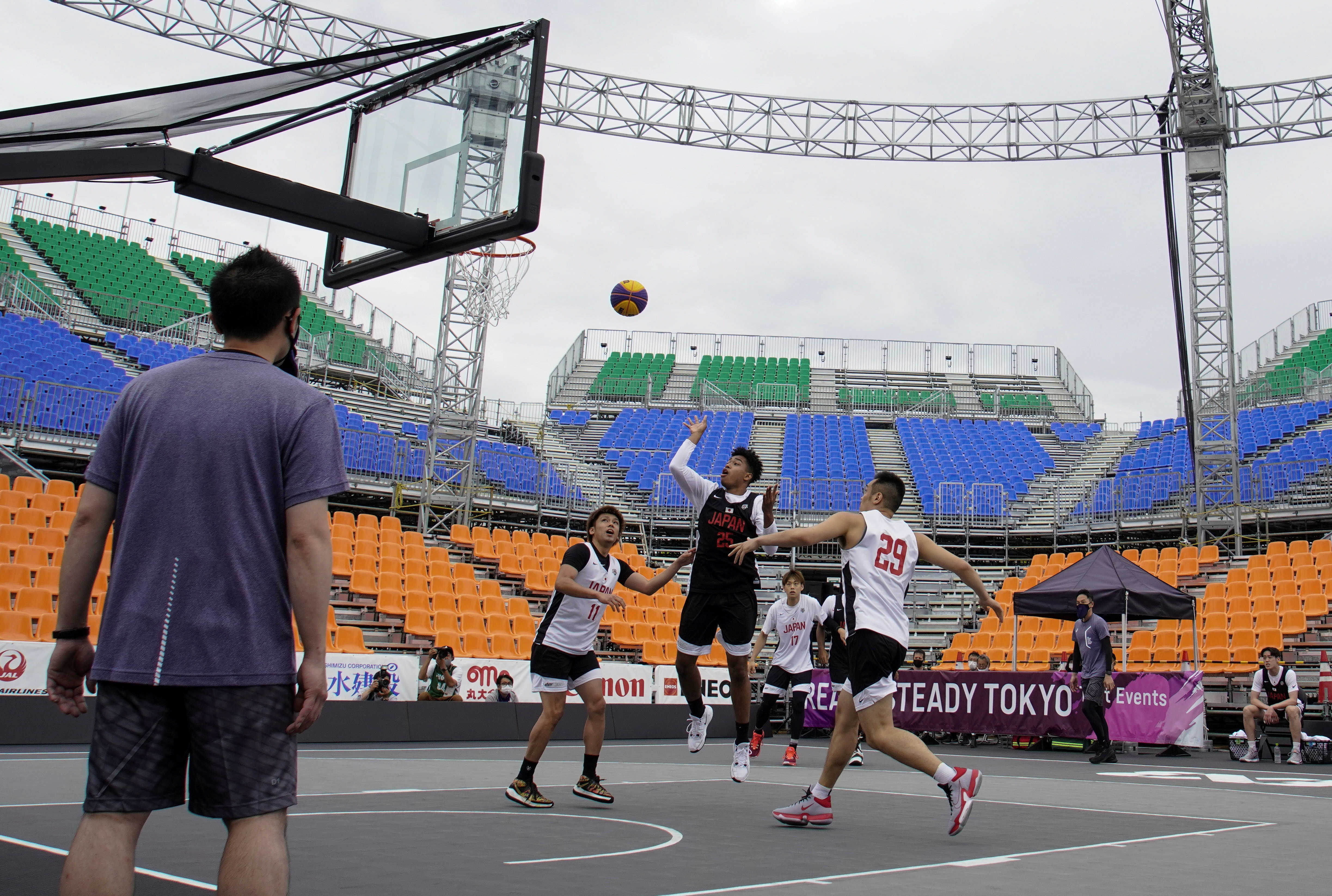 Participants compete in a men's 3x3 basketball event during the Tokyo 2020 Olympics 3x3 basketball test event at Aomi Urban Sports Park in Tokyo, Japan May 16, 2021. REUTERS/Naoki Ogura