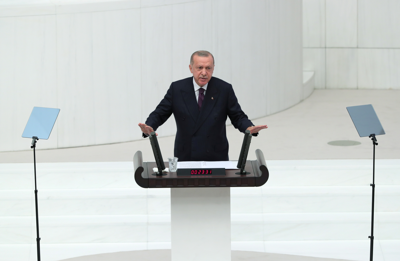 Turkey's President Tayyip Erdogan addresses members of parliament as he attends the reopening of the Turkish parliament after the summer recess in Ankara, Turkey, October 1, 2021. Murat Cetinmuhurdar/PPO/Handout via REUTERS