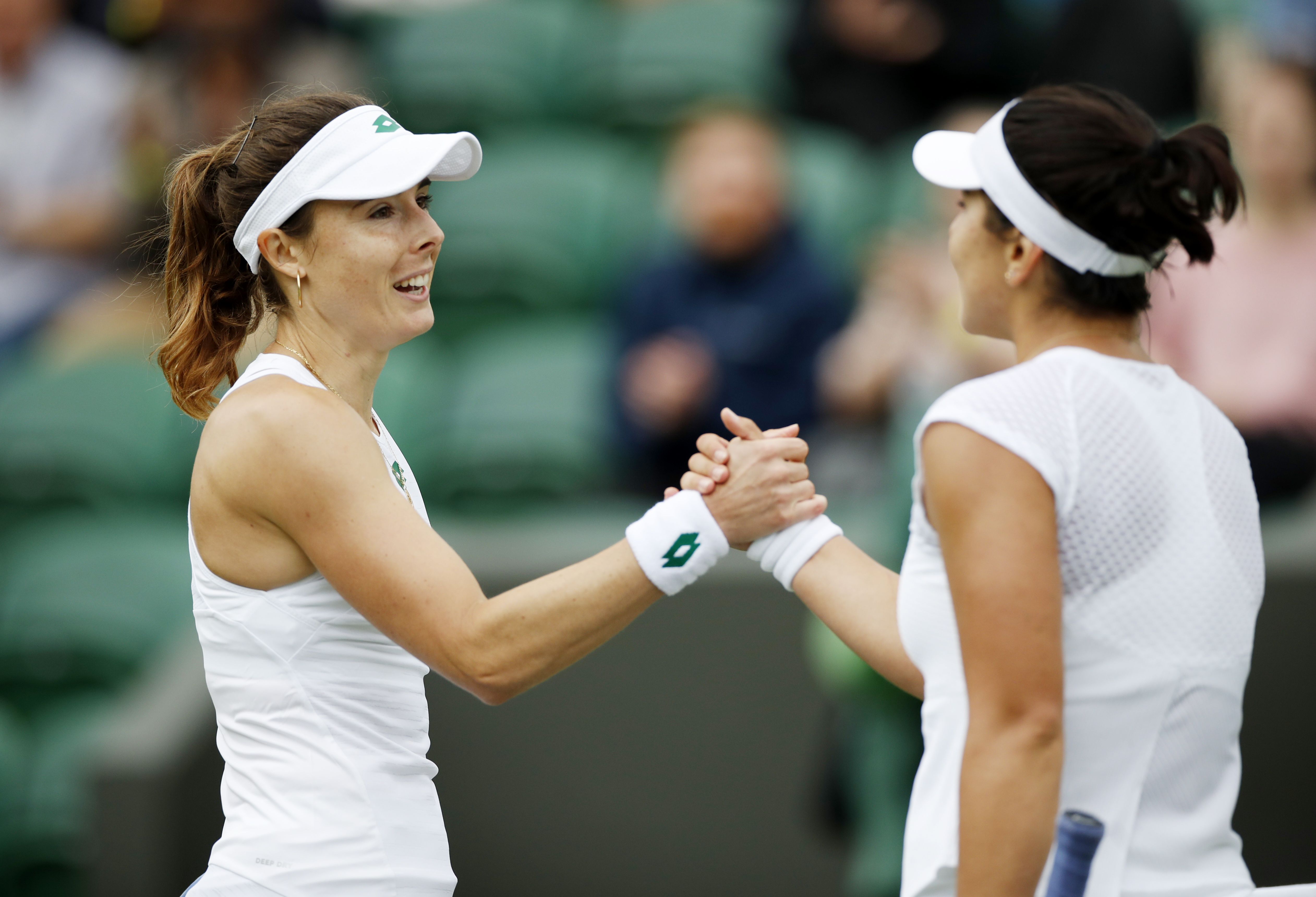 Tennis - Wimbledon - All England Lawn Tennis and Croquet Club, London, Britain - June 30, 2021 France's Alize Cornet shakes hands with Canada's Bianca Andreescu after winning their first round match REUTERS/Paul Childs