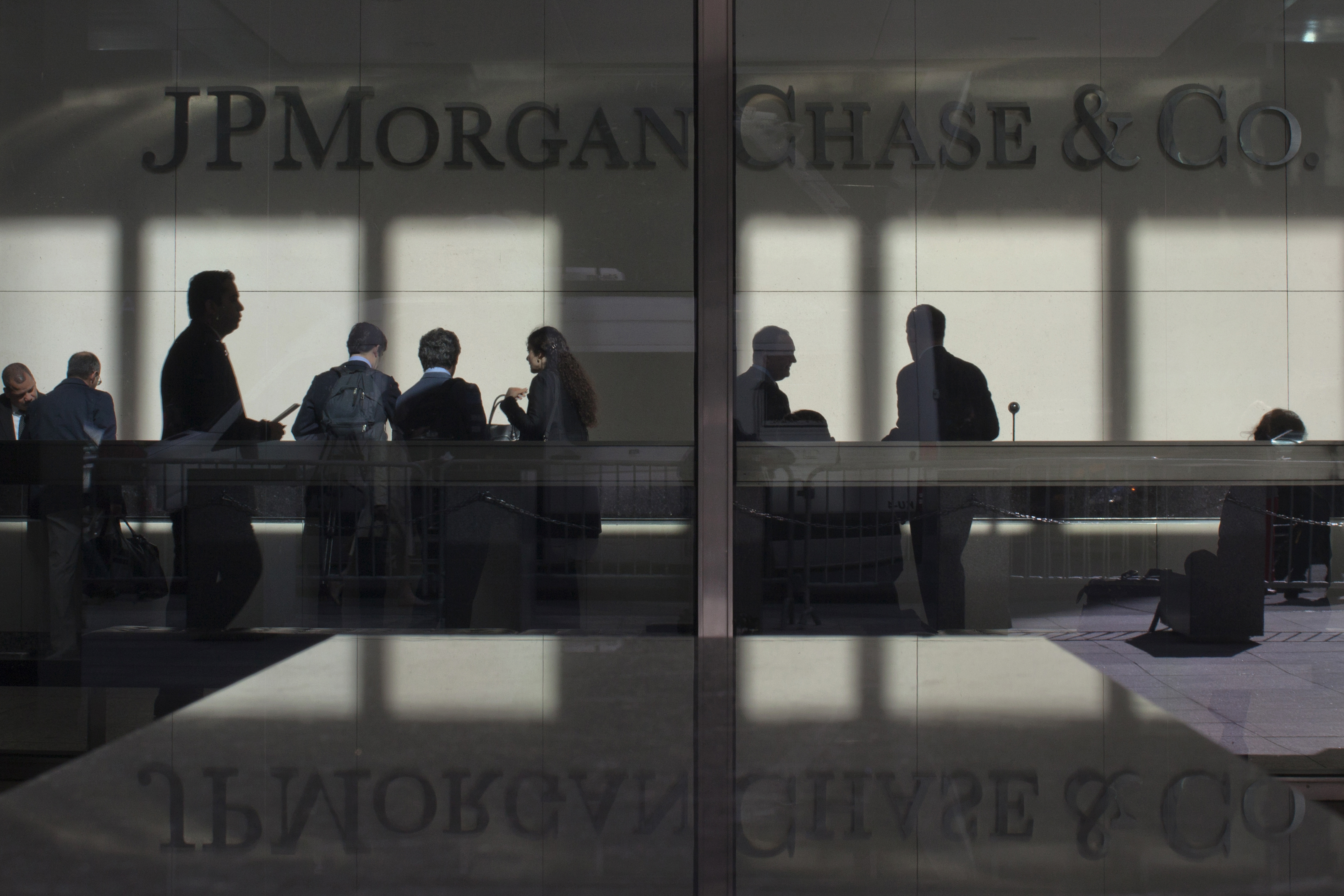 File photo: The lobby of JP Morgan headquarters is photographed through it's front doors in New York May 11, 2012.  REUTERS/Eduardo Munoz.
