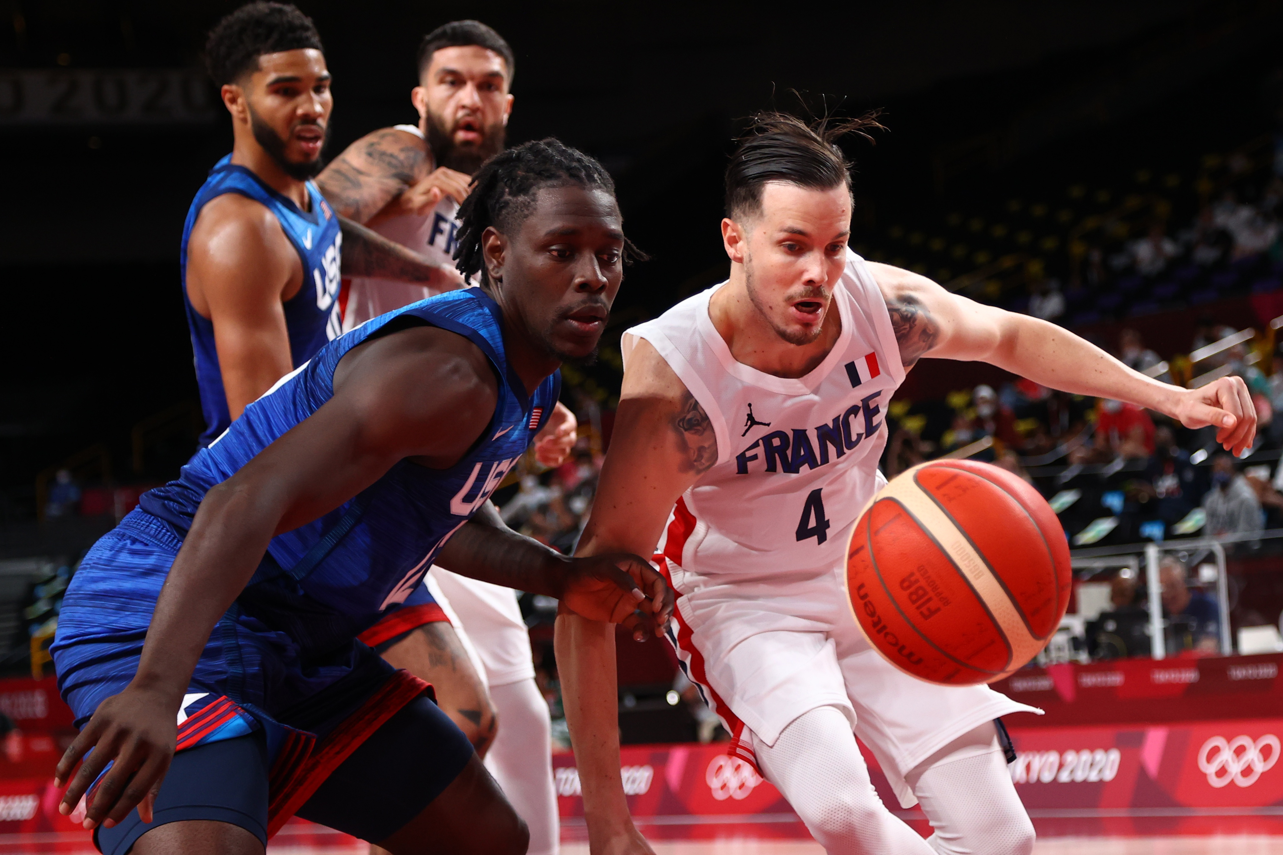 Tokyo 2020 Olympics - Basketball - Men - Group A - France v United States - Saitama Super Arena, Saitama, Japan - July 25, 2021. Jrue Holiday of the United States in action with Thomas Heurtel of France REUTERS/Brian Snyder