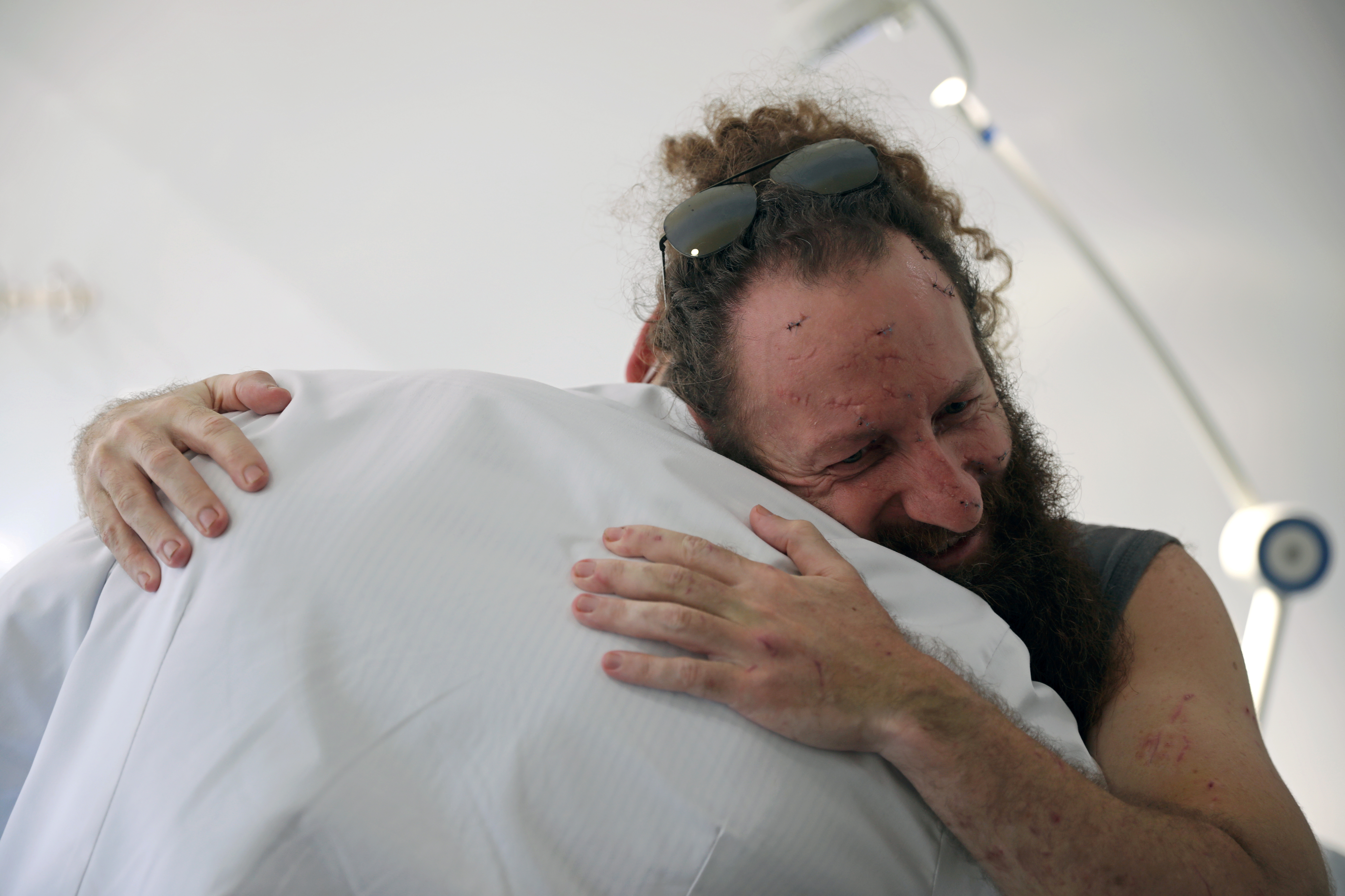 Shady Rizk, 36, hugs plastic surgeon Dr. Joe Baroud, 33, who offers his services for free to people injured by a massive explosion at the port area, in Beirut, Lebanon, August 20, 2020. Picture taken August 20, 2020. REUTERS/Alkis Konstantinidis/File Photo