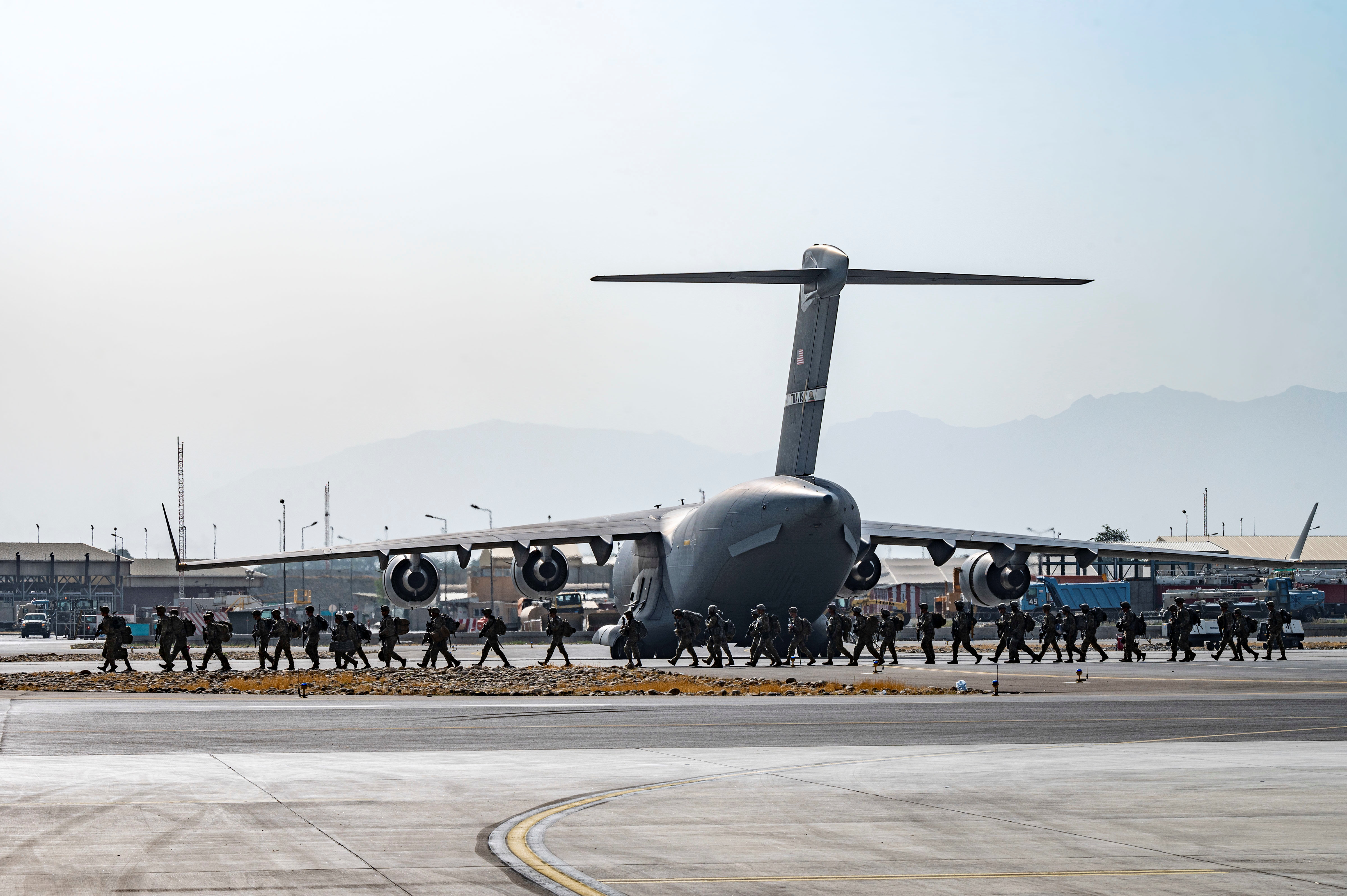 U.S. Soldiers, assigned to the 82nd Airborne Division, arrive to provide security in support of Operation Allies Refuge at Hamid Karzai International Airport in Kabul, Afghanistan, August 20, 2021. Senior Airman Taylor Crul/U.S. Air Force/Handout via REUTERS