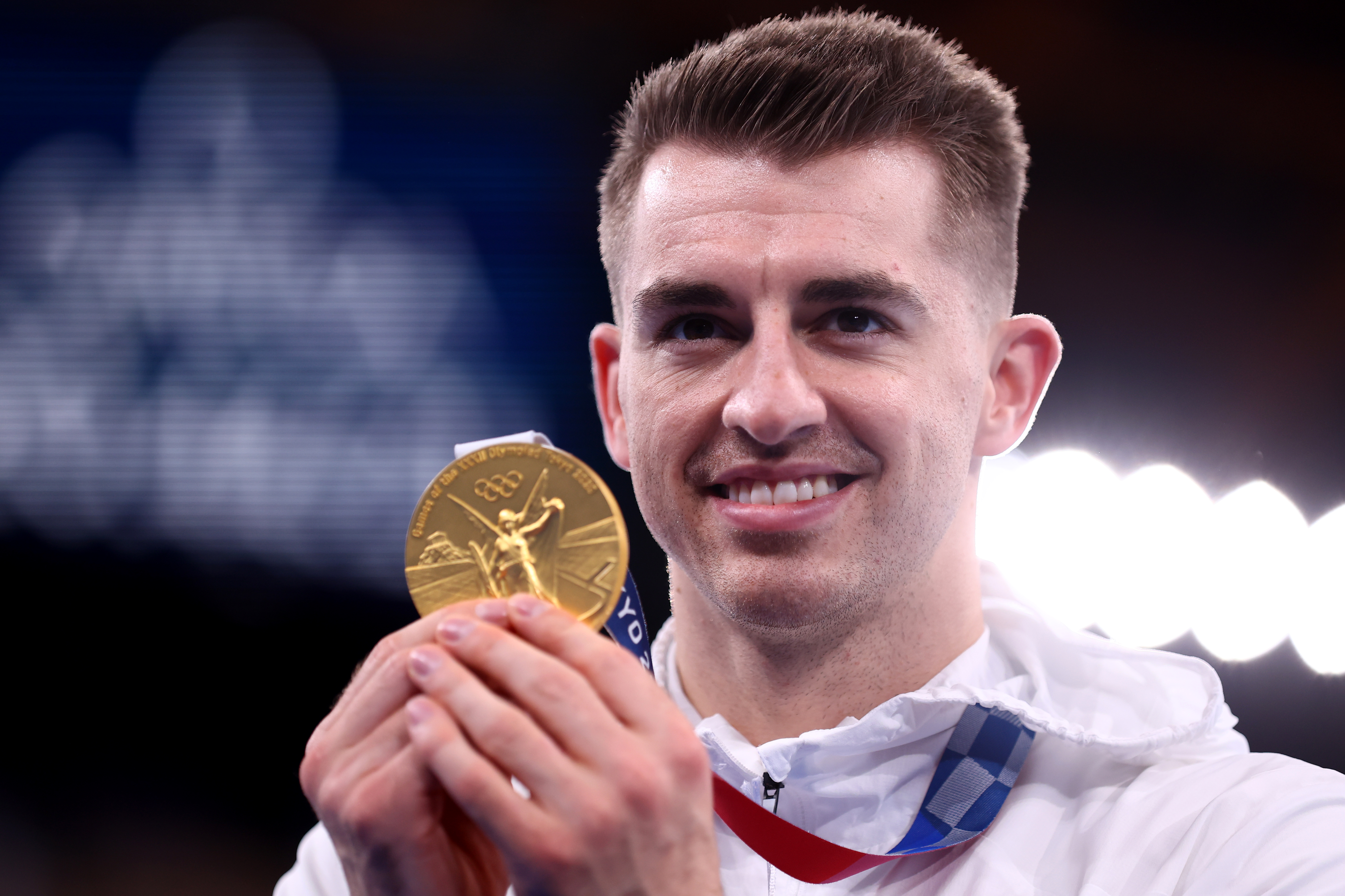 Tokyo 2020 Olympics - Gymnastics - Artistic - Men's Pommel Horse - Medal Ceremony - Ariake Gymnastics Centre, Tokyo, Japan - August 1, 2021. Gold medallist Max Whitlock of Britain poses with his medal REUTERS/Mike Blake
