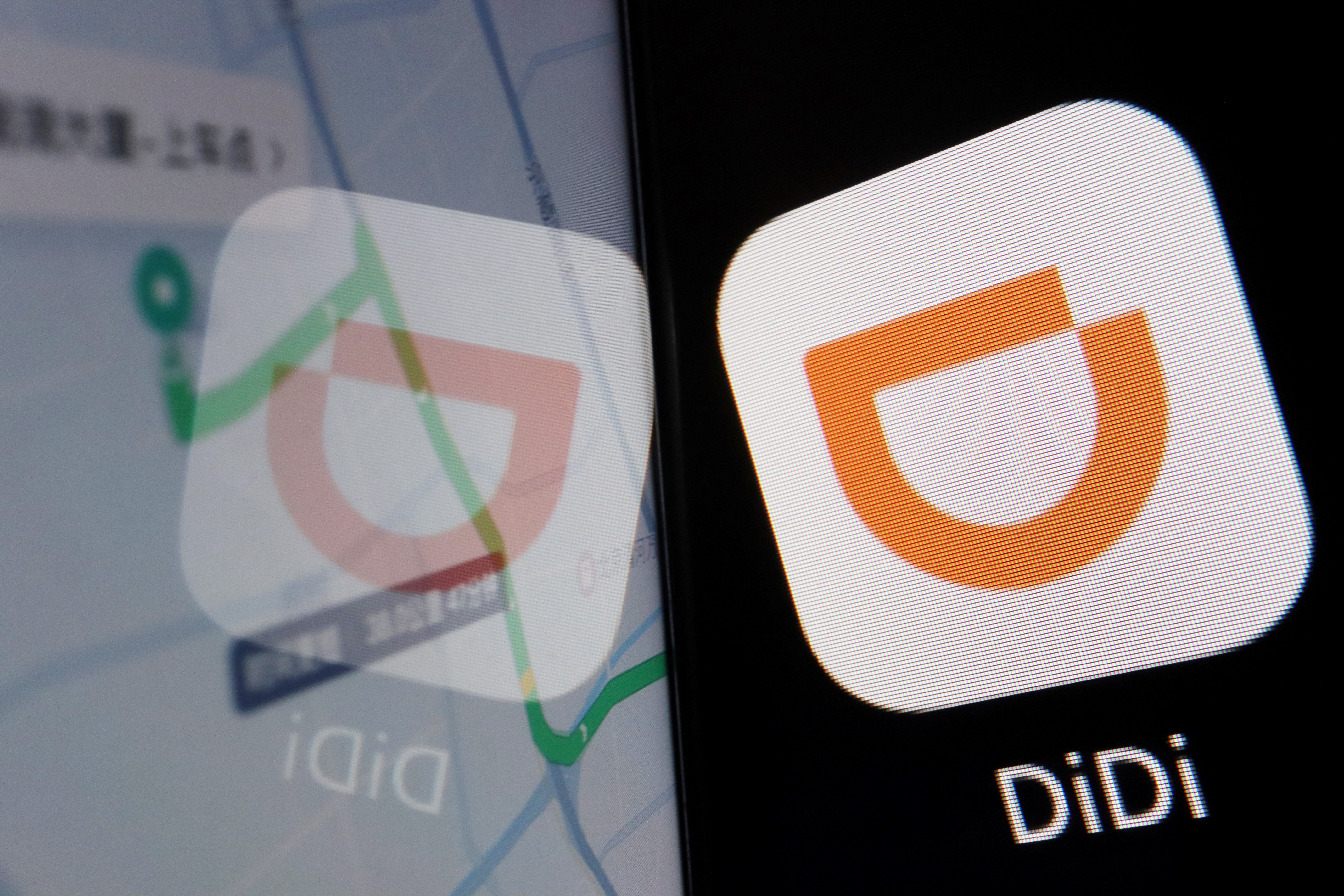 The app logo of Chinese ride-hailing giant Didi is seen reflected on its navigation map displayed on a mobile phone in this illustration picture taken July 1, 2021. REUTERS/Florence Lo/Illustration/File Photo
