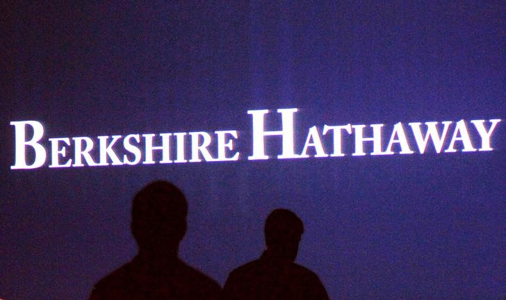 Berkshire Hathaway shareholders walk by a video screen at the company's annual meeting in Omaha May 4, 2013.  REUTERS/Rick Wilking/File Photo