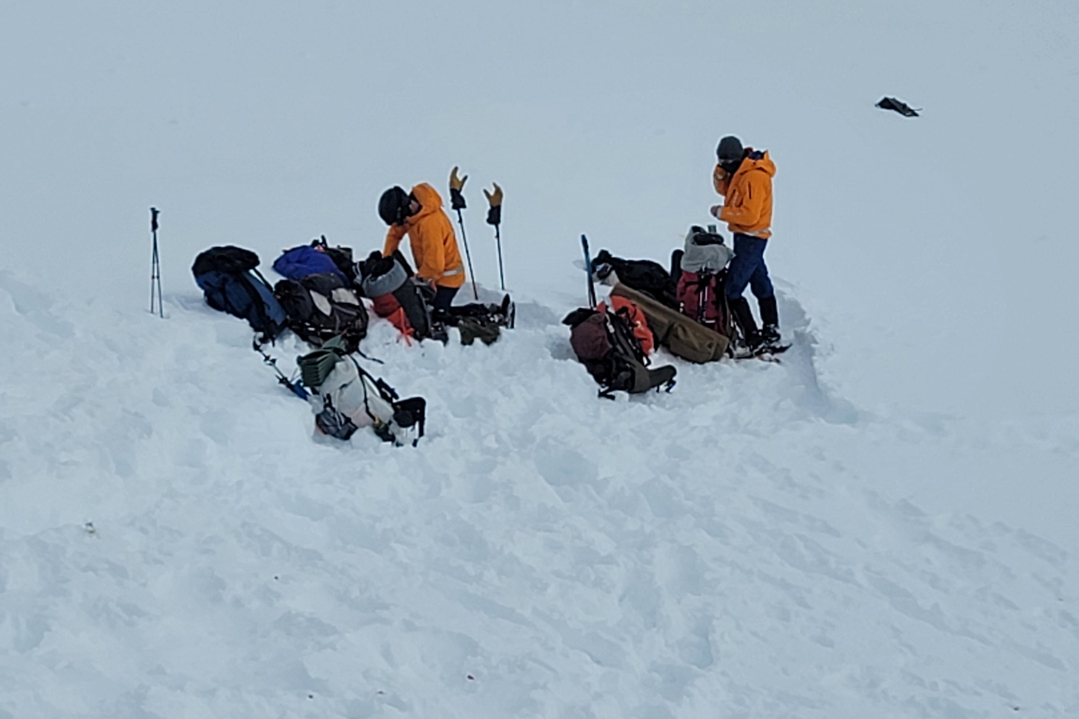 Alaska Mountain Rescue Group volunteers assemble near the site of a helicopter crash which killed five people, including Petr Kellner, the Czech Republic's richest man and founder of investment group PPF, near Knik Glacier, northeast of Anchorage, Alaska, U.S.  March 28, 2021.  Alaska Mountain Rescue Group/Handout via REUTERS