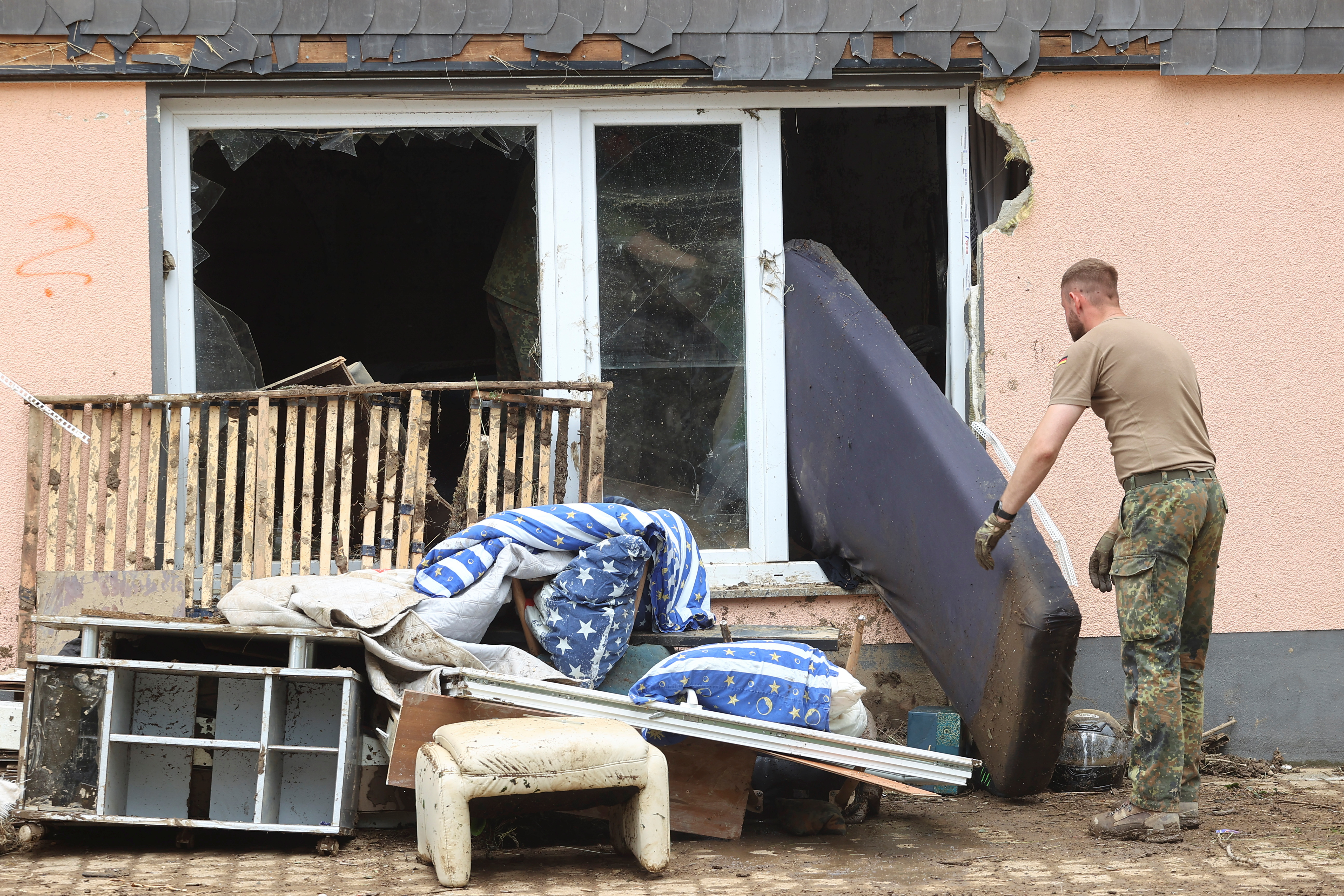 Members of the Bundeswehr forces work in an area affected by floods caused by heavy rainfalls in Schuld, Germany, July 19, 2021. REUTERS/Wolfgang Rattay