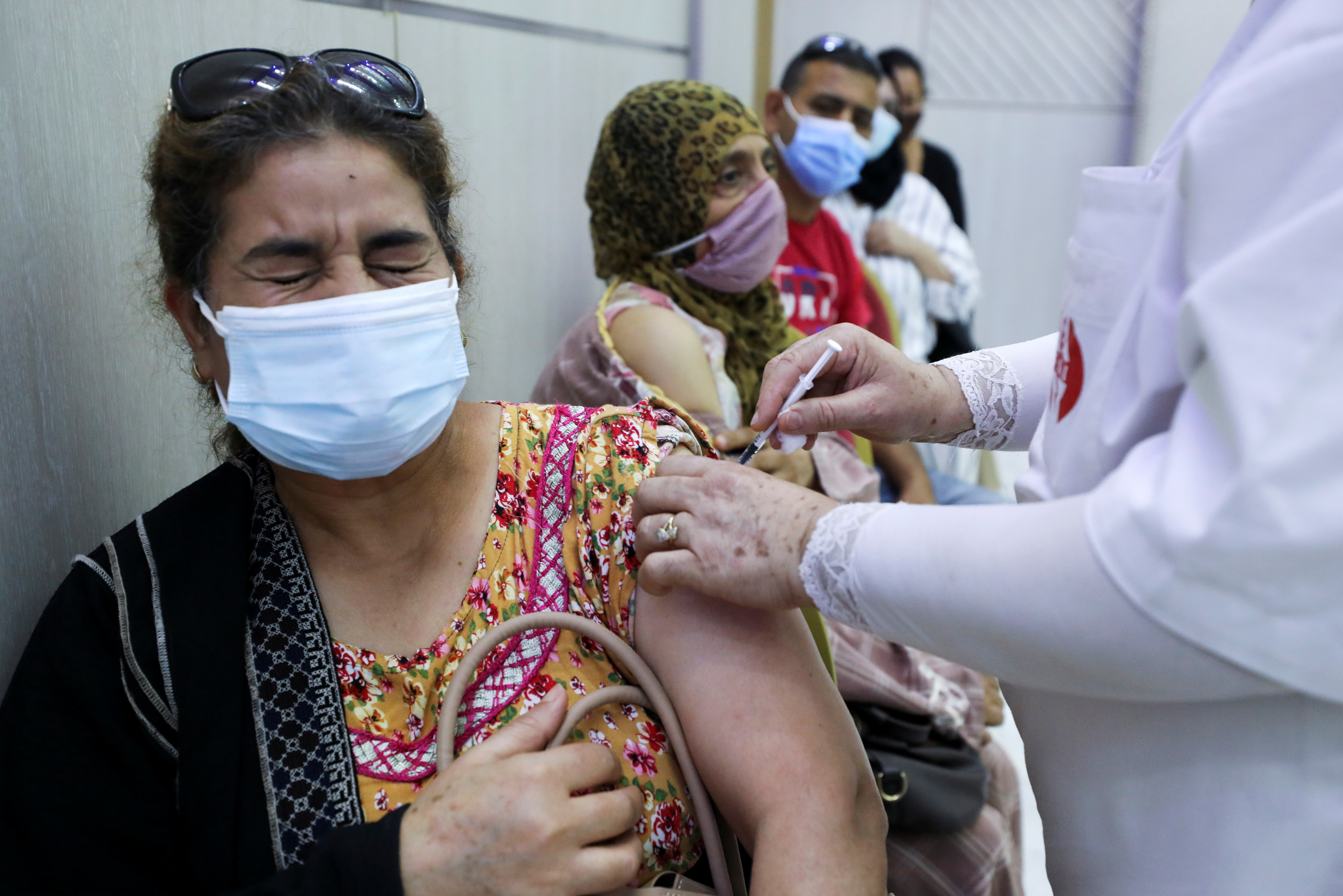 A woman receives the COVID-19 vaccine at a vaccination center in Tunis, Tunisia. REUTERS/Ammar Awad