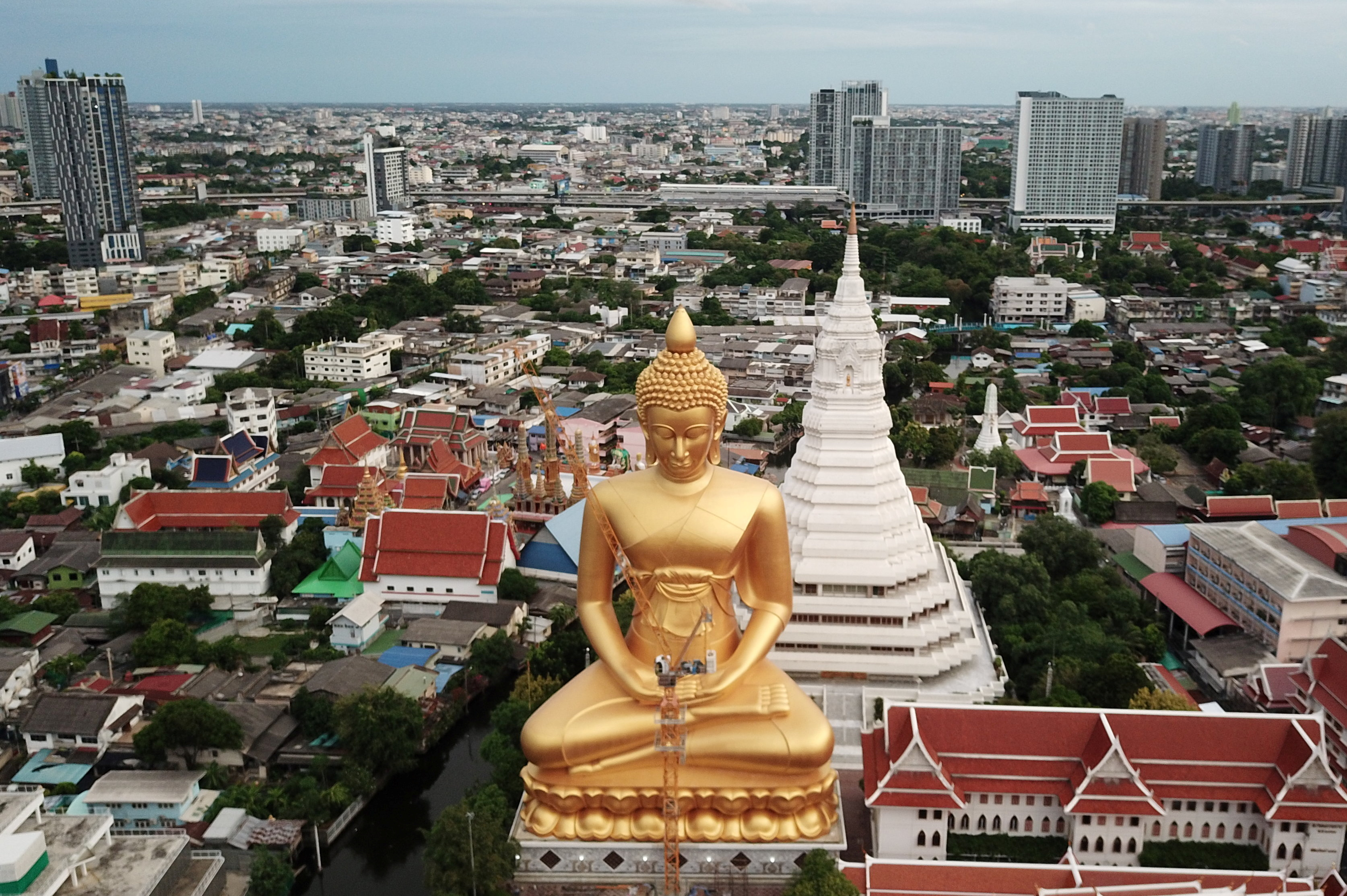 The giant Buddha statue of Wat Paknam Phasi Charoen temple is seen in Bangkok, Thailand, June 10, 2021. Picture taken June 10, 2021 with a drone. REUTERS/Jorge Silva