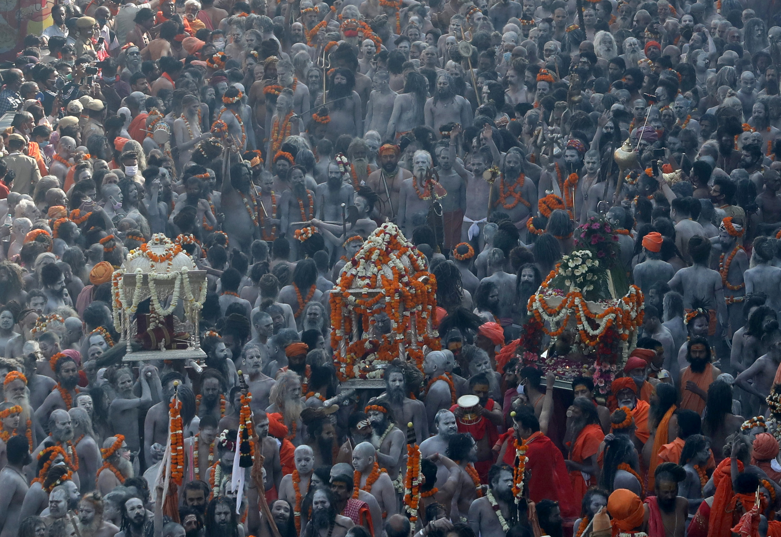 SENSITIVE MATERIAL. THIS IMAGE MAY OFFEND OR DISTURB  Naga Sadhus, or Hindu holy men participate in a procession to take a dip in the Ganges river during Shahi Snan at