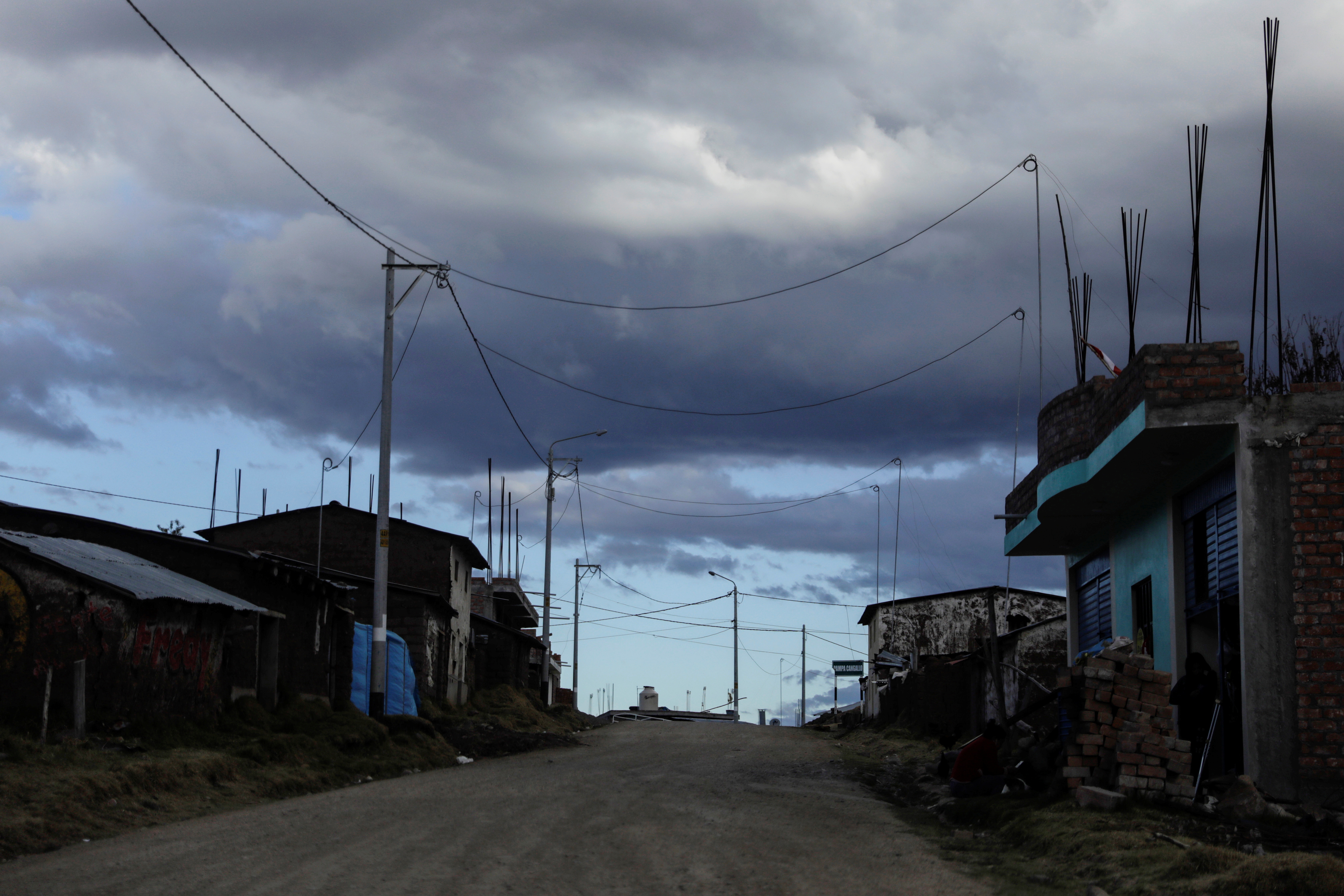 A street is seen at dusk in the region where Shining Path, the Peruvian guerrilla group whose founder Abimael Guzman recently died, was once active, near Ayacucho, Peru September 13, 2021. Picture taken September 13, 2021. REUTERS/Alessandro Cinque