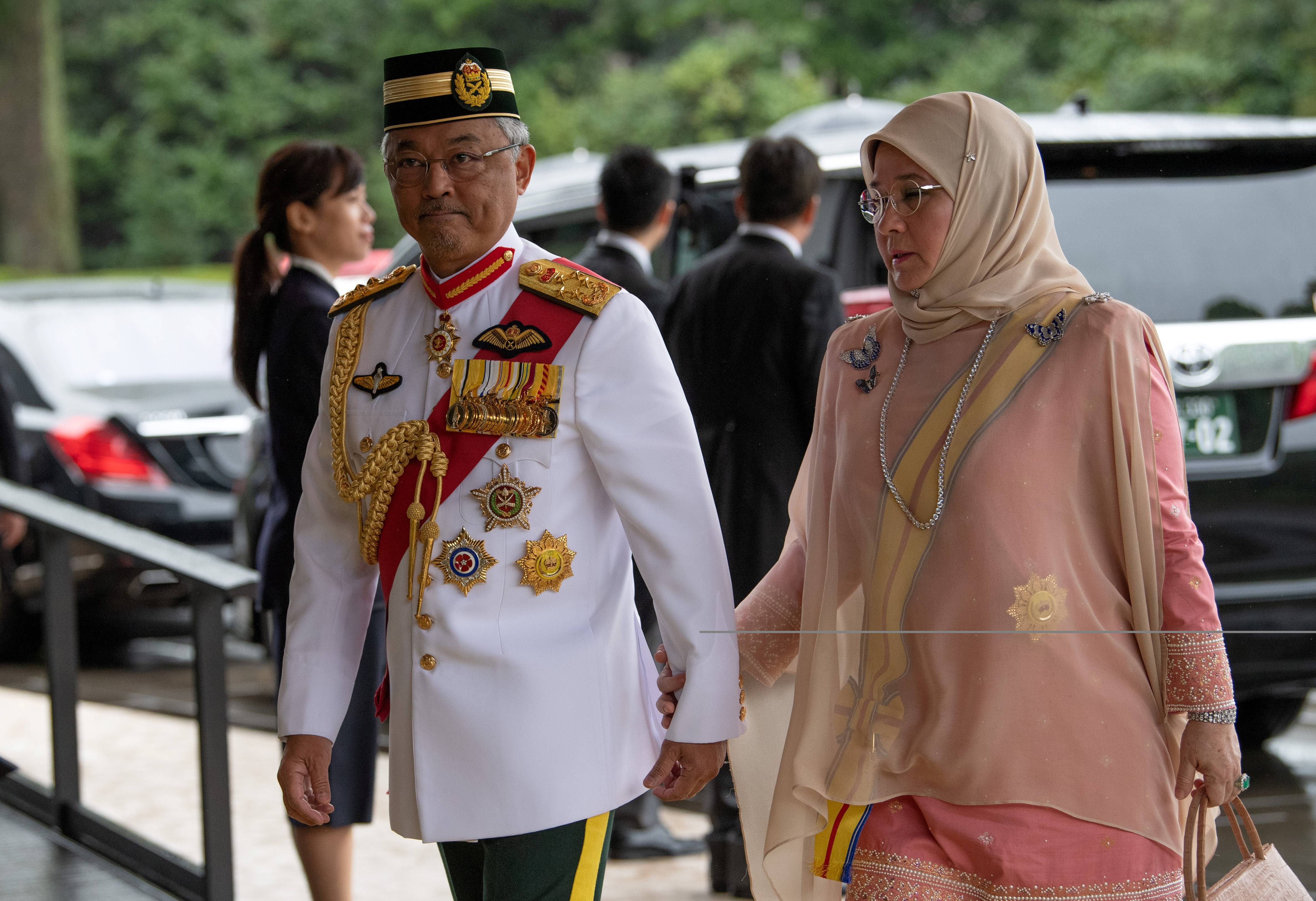 Malaysia's King Sultan Abdullah Sultan Ahmad Shah and Queen Tunku Azizah Aminah Maimunah arrive for the enthronement ceremony of Japan's Emperor Naruhito at the Imperial Palace in Tokyo, Japan October 22, 2019.  Carl Court/Pool via REUTERS