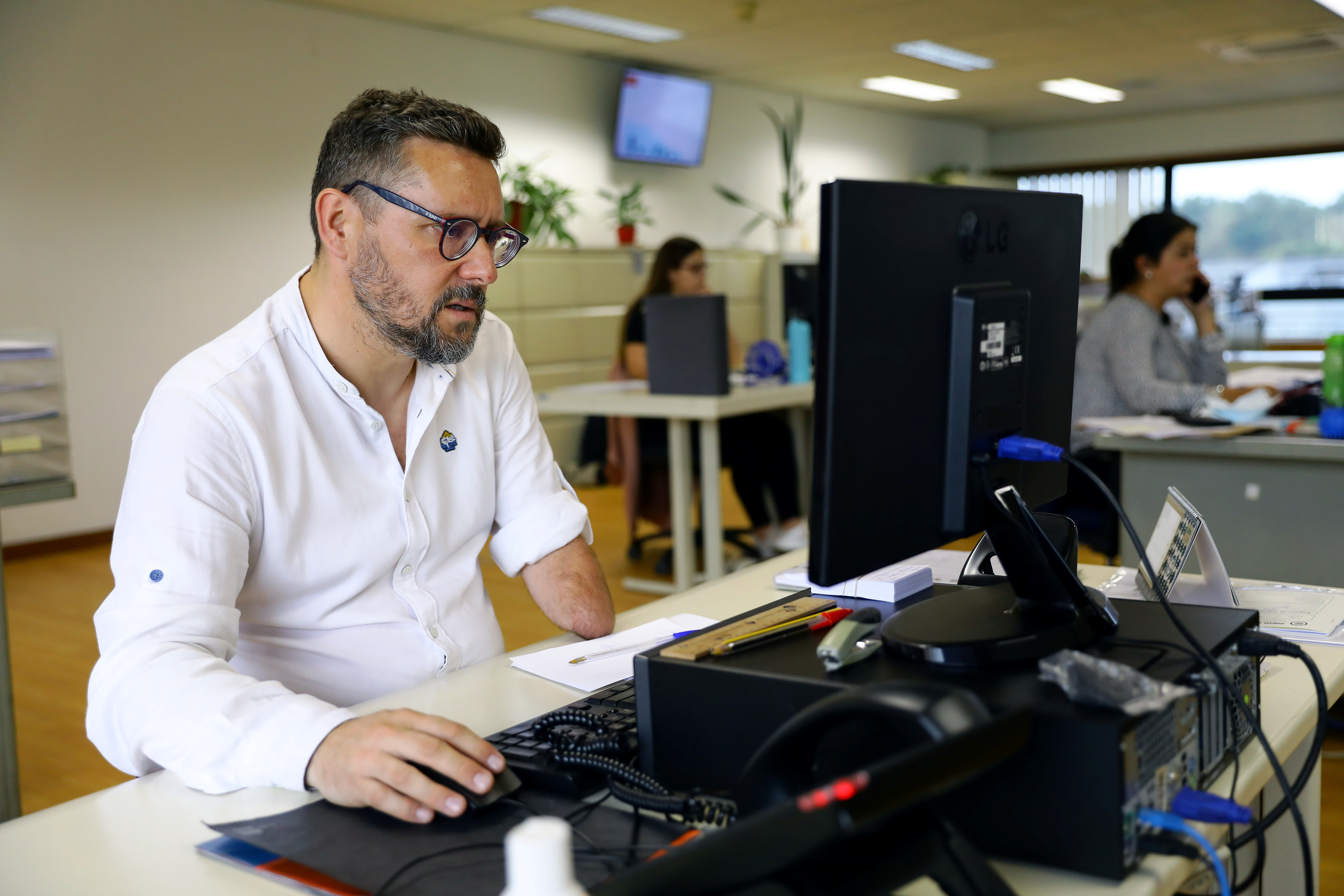 Rui Brito, a worker with a disability who lost his arm in a machinery accident more than 30 years ago, works at the office in Porto, Portugal, July 20, 2021. Picture taken July 20, 2021.  REUTERS/Violeta Santos Moura