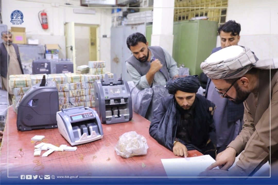 Men are pictured as Afghanistan's Taliban-controlled central bank seizes a large amount of money in cash and gold from former top government officials, including former vice president Amrullah Saleh, in Afghanistan, in this handout obtained by Reuters on September 15, 2021. Da Afghanistan Bank/Handout via REUTERS