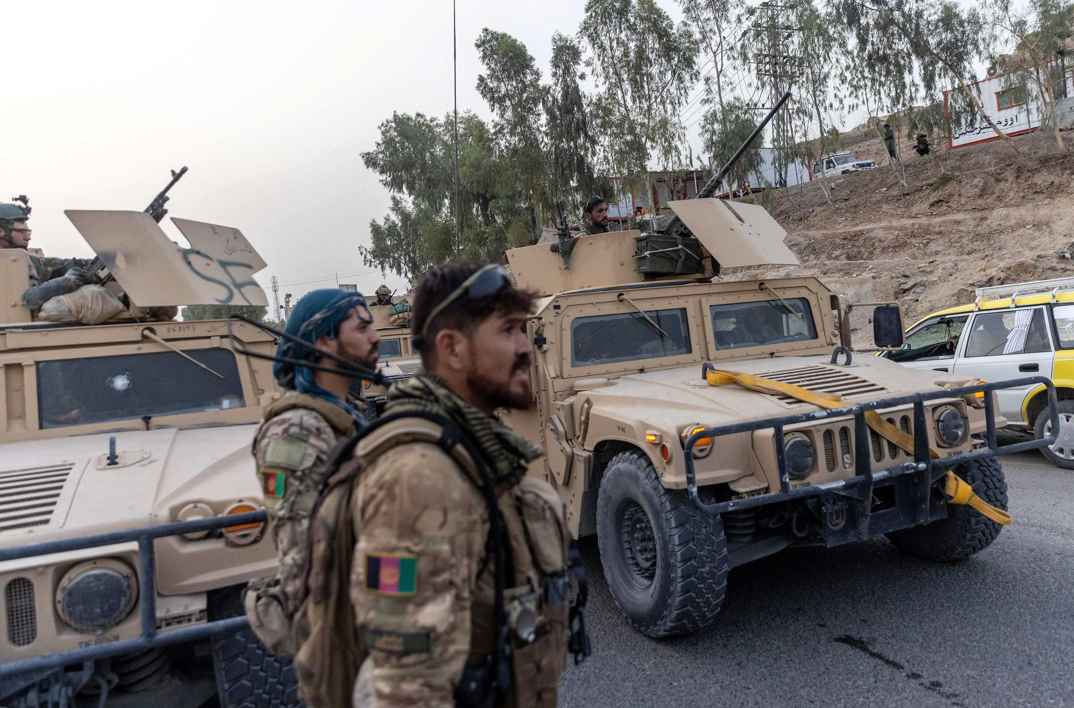 A convoy of Afghan Special Forces is seen during the rescue mission of a policeman besieged at a check post surrounded by Taliban, in Kandahar province, Afghanistan, July 13, 2021. Picture taken July 13, 2021.REUTERS/Danish Siddiqui