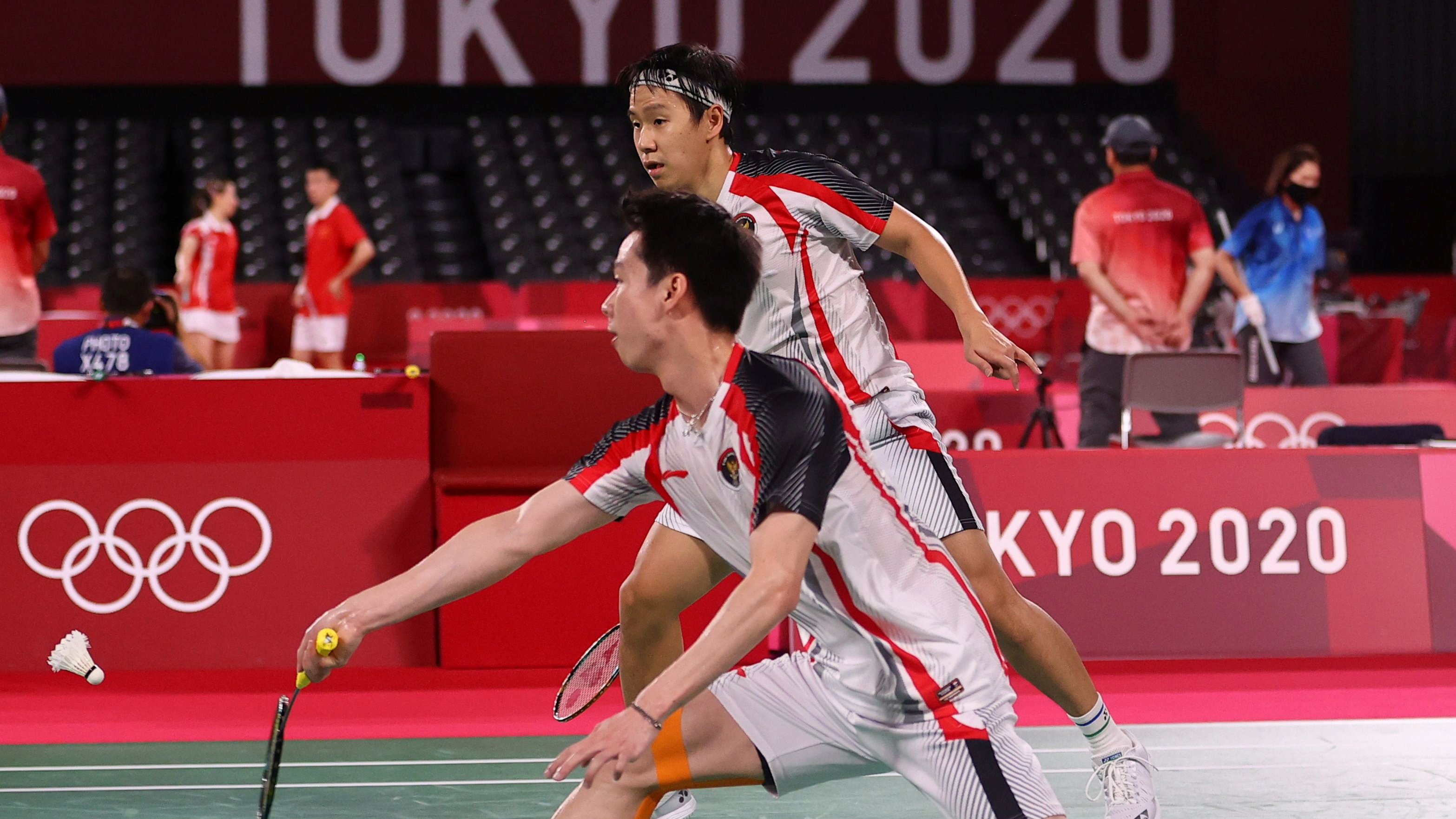 Tokyo 2020 Olympics - Badminton - Men's Doubles - Quarterfinal - MFS - Musashino Forest Sport Plaza, Tokyo, Japan – July 29, 2021. Kevin Sanjaya Sukamuljo of Indonesia in action as Marcus Fernaldi Gideon of Indonesia looks on during the match against Aaron Chia of Malaysia and Soh Wooi Yik of Malaysia. REUTERS/Hamad I Mohammed
