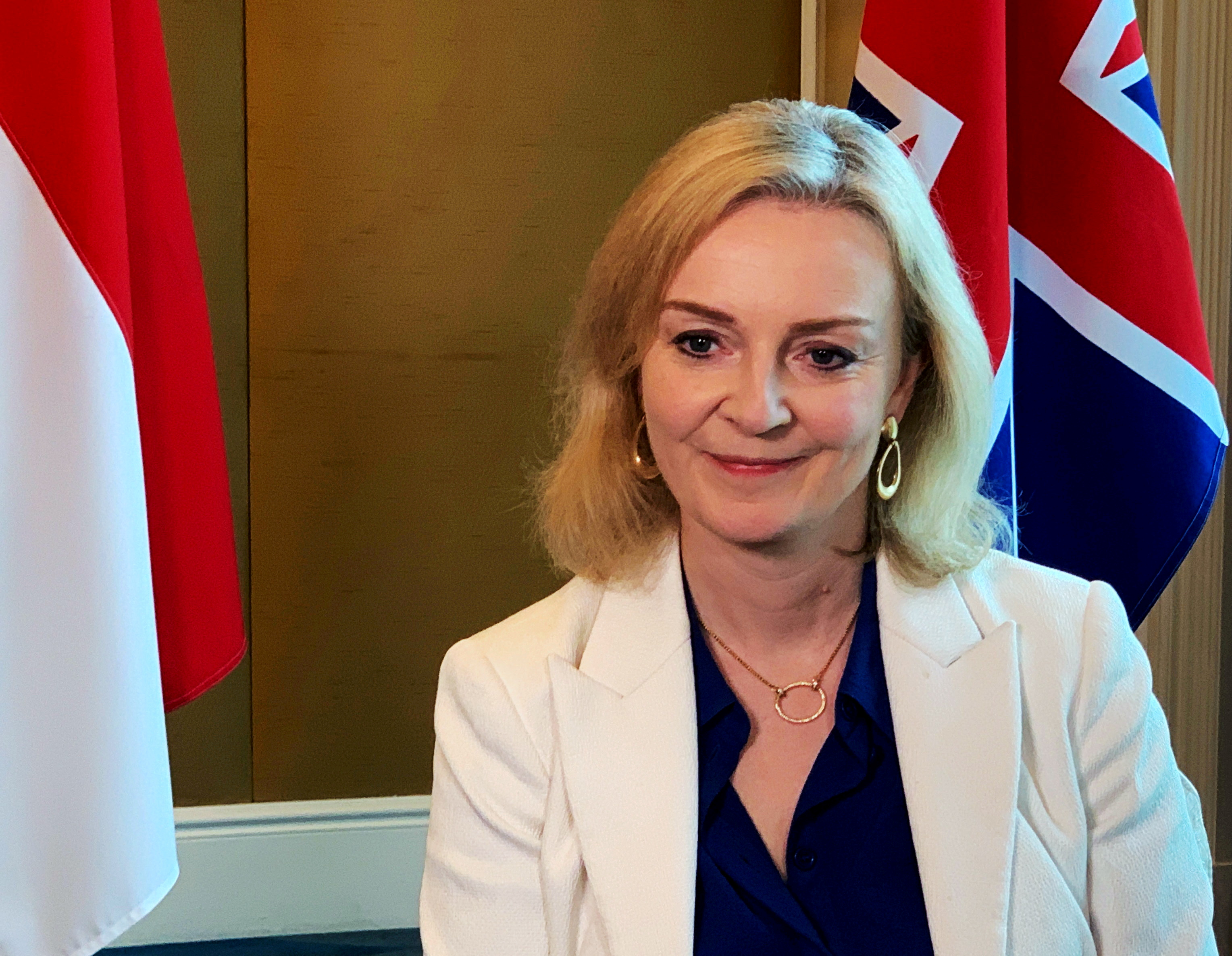British trade minister Liz Truss speaks to Reuters after signing a free trade agreement with Singapore, in Singapore, December 10, 2020.  REUTERS/Pedja Stanisic//File Photo