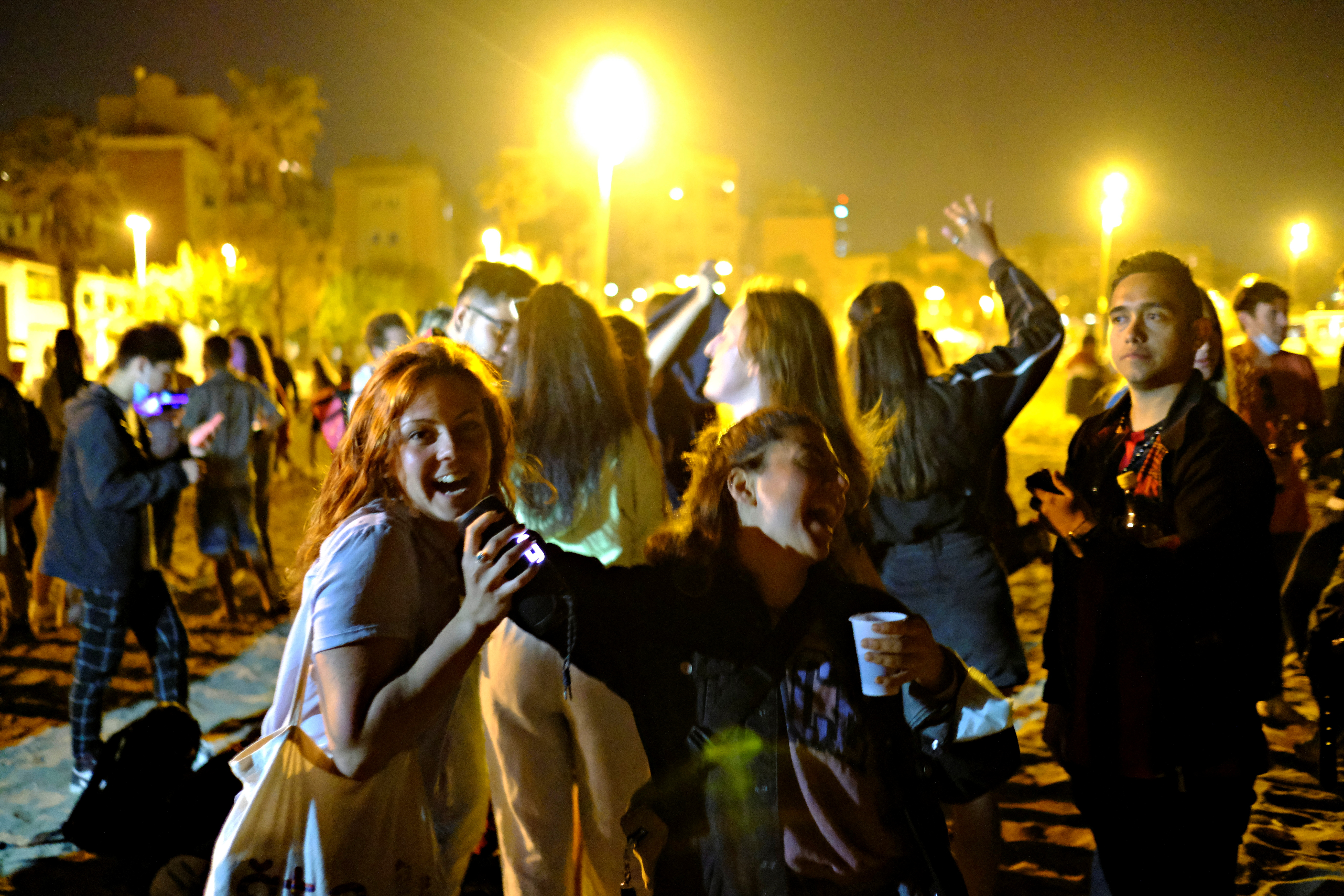 People dance at the Barcelona beach, as the state of alarm decreed by the Spanish Government to prevent the spread of the coronavirus disease (COVID-19) is due to end on Sunday, in Barcelona, Spain, May 8, 2021. Picture taken May, 8, 2021. REUTERS/Nacho Doce