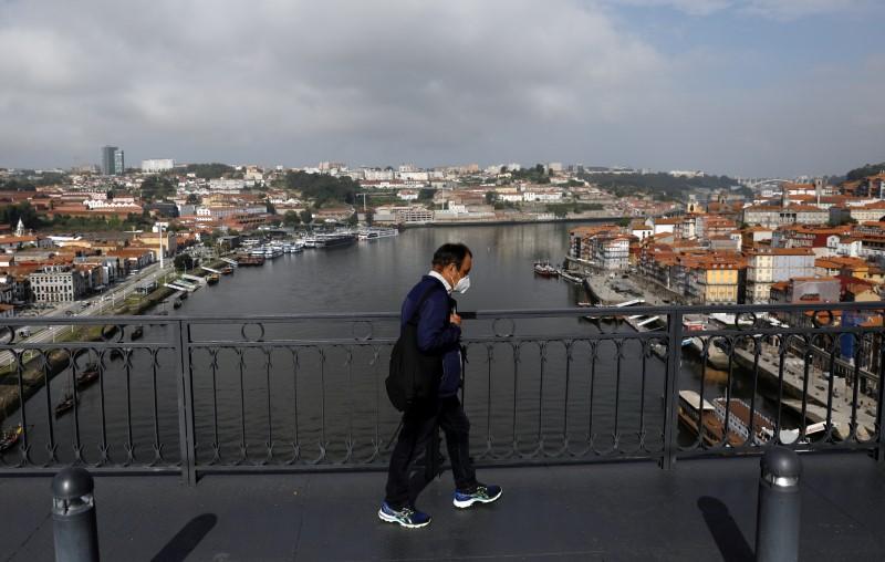 A man walks on Dom Luis I Bridge in Porto ahead of the Champions League Final, May 28, 2021.  REUTERS/Pedro Nunes/File Photo
