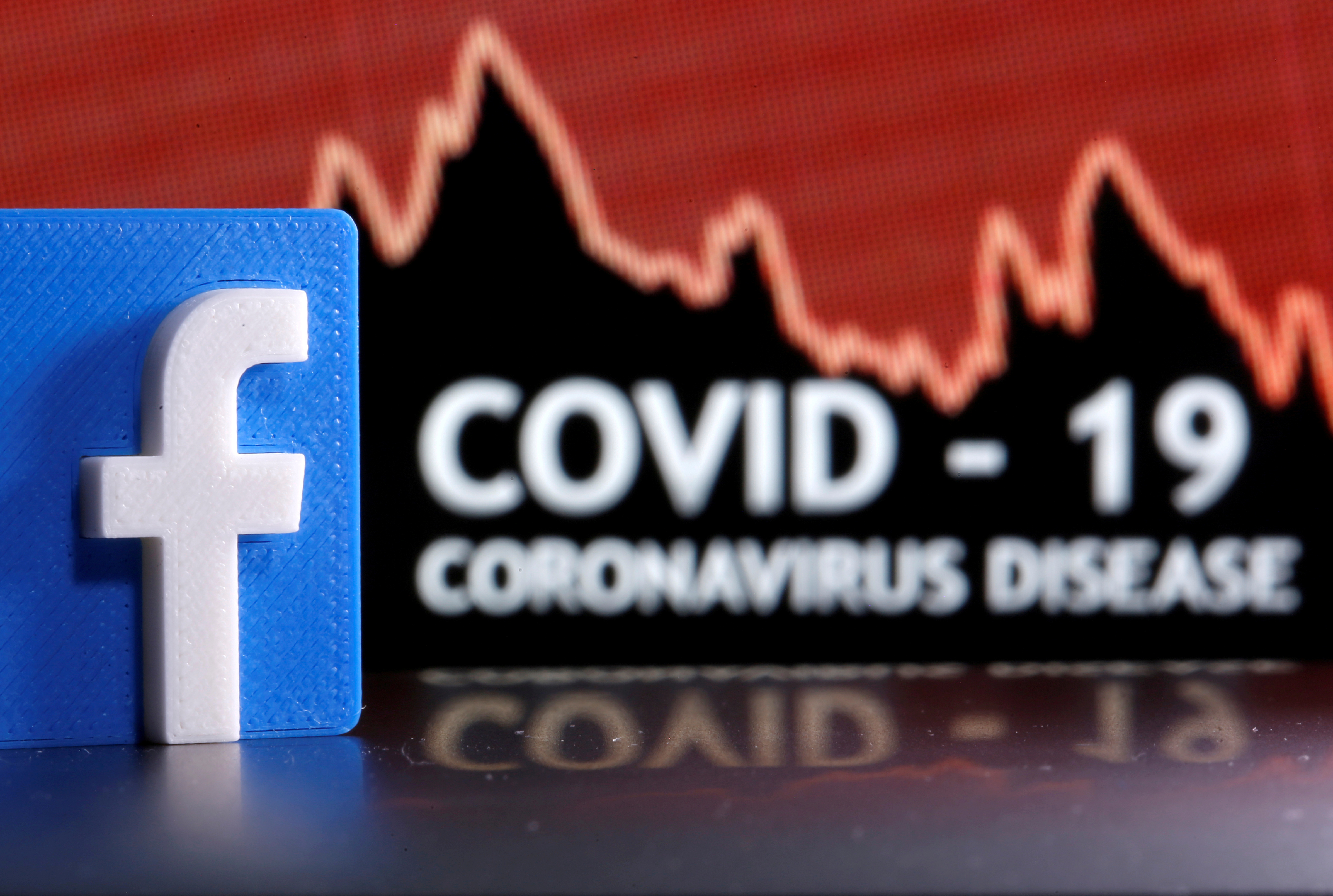 A 3D-printed Facebook logo is seen in front of displayed coronavirus disease (COVID-19) words in this illustration taken March 24, 2020. Picture taken March 24, 2020. REUTERS/Dado Ruvic/Illustration/File Photo