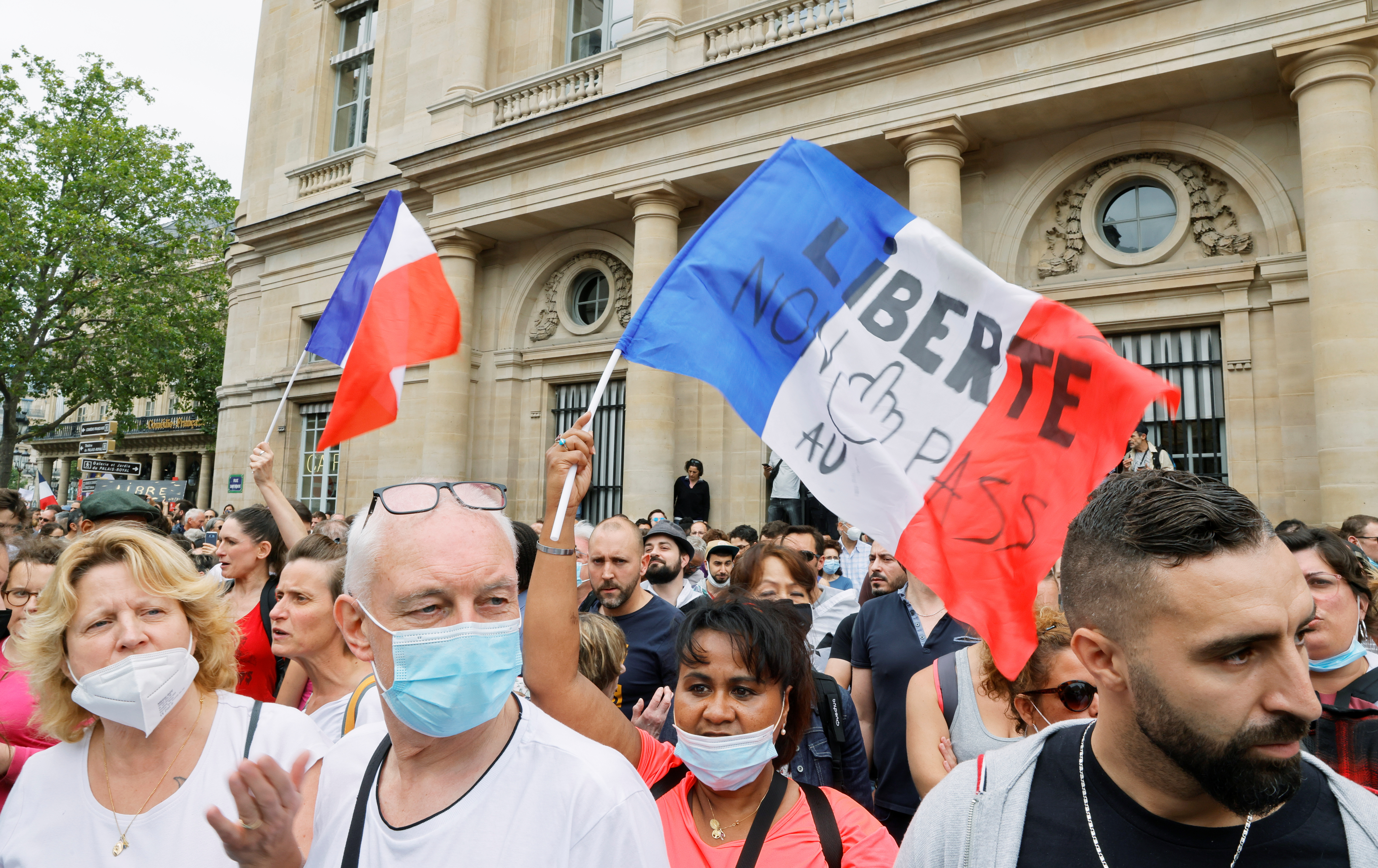 Demonstrators attend a protest against the new measures announced by French President Emmanuel Macron to fight the coronavirus disease (COVID-19) outbreak, in Paris, France, July 17, 2021. REUTERS/Pascal Rossignol