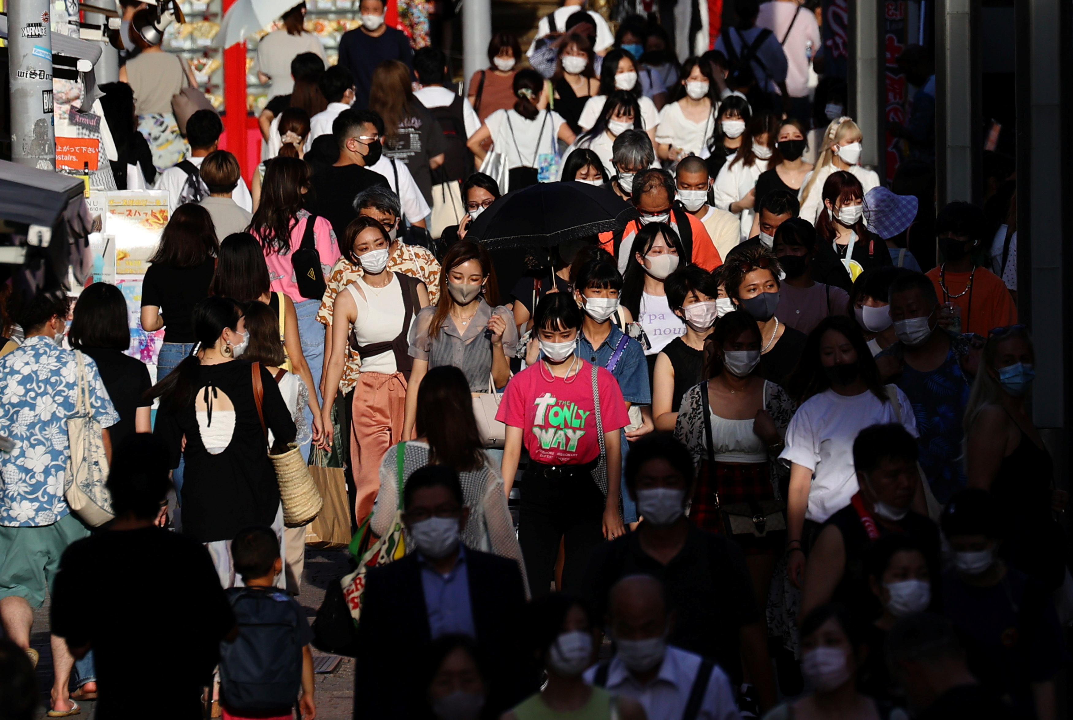 People wearing protective masks, amid the coronavirus disease (COVID-19) outbreak, make their way at a shopping district in Tokyo , Japan, August 5, 2021.   REUTERS/Kim Kyung-Hoon