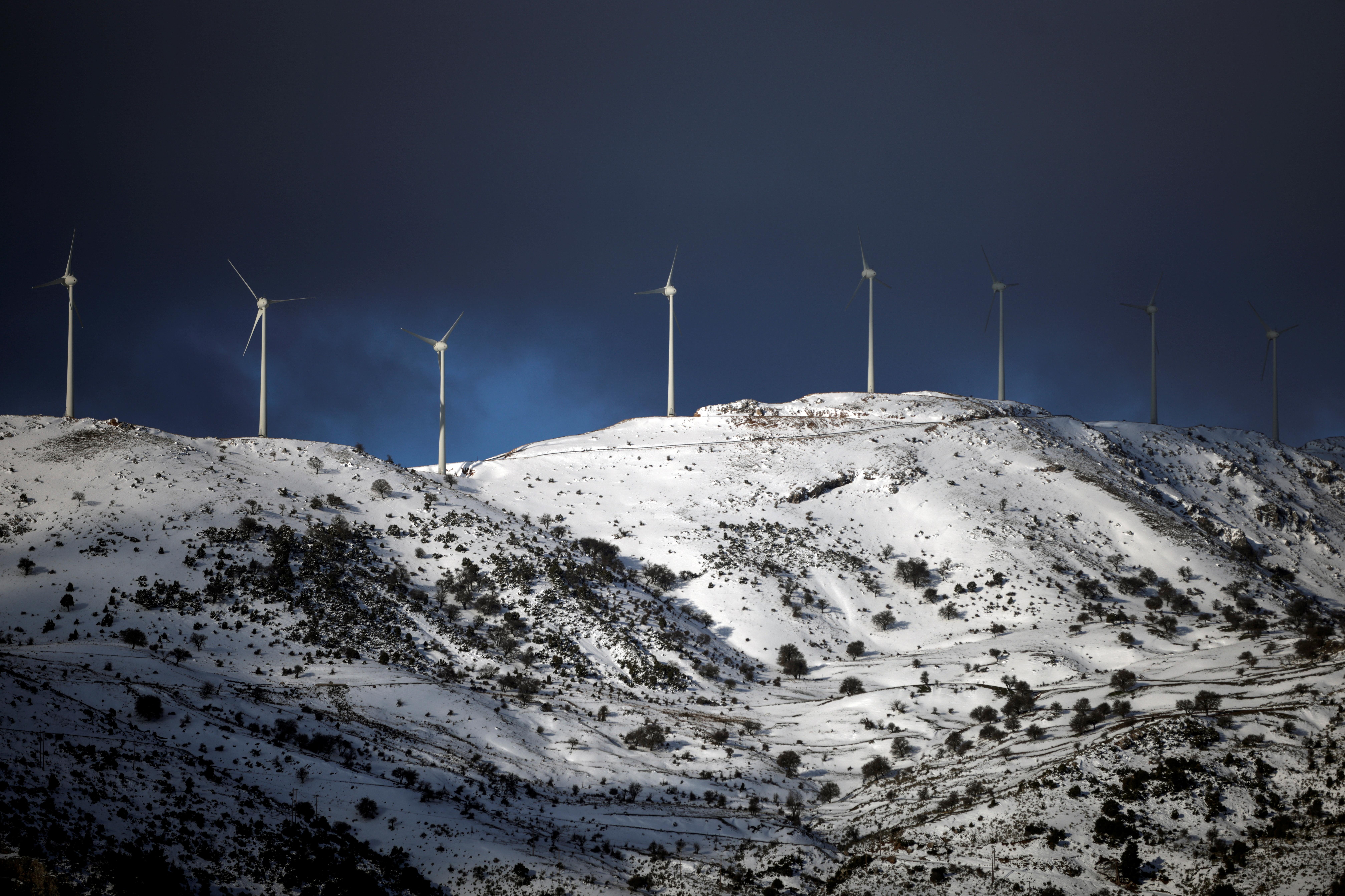 Wind turbines operate on a snowy mountain near the town of Kalavrita, Greece, March 17, 2021. REUTERS/Alkis Konstantinidis