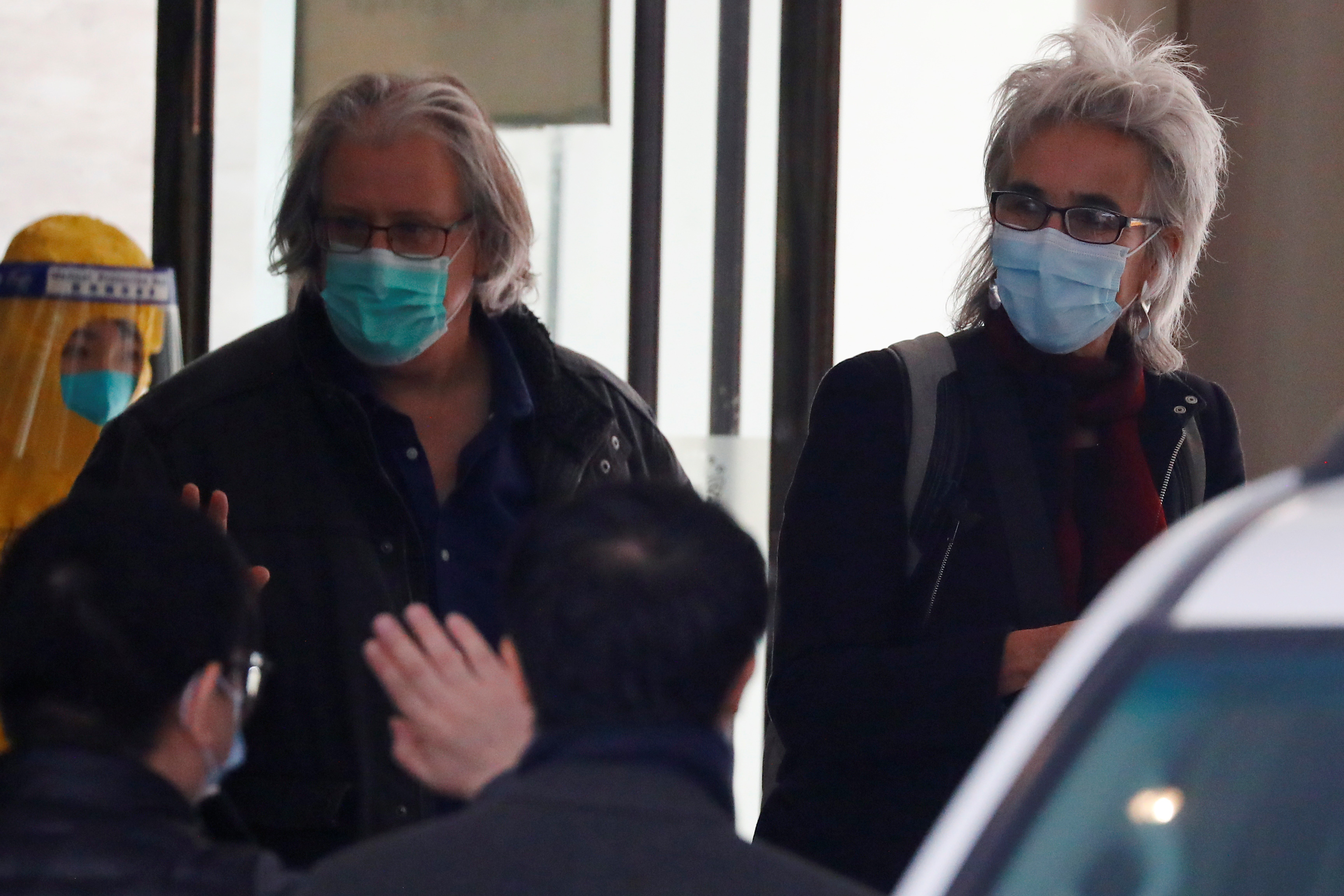 Members of the World Health Organisation (WHO) team tasked with investigating the origins of the coronavirus disease (COVID-19) pandemic leave their quarantine hotel in Wuhan, Hubei province, China January 28, 2021. REUTERS/Thomas Peter