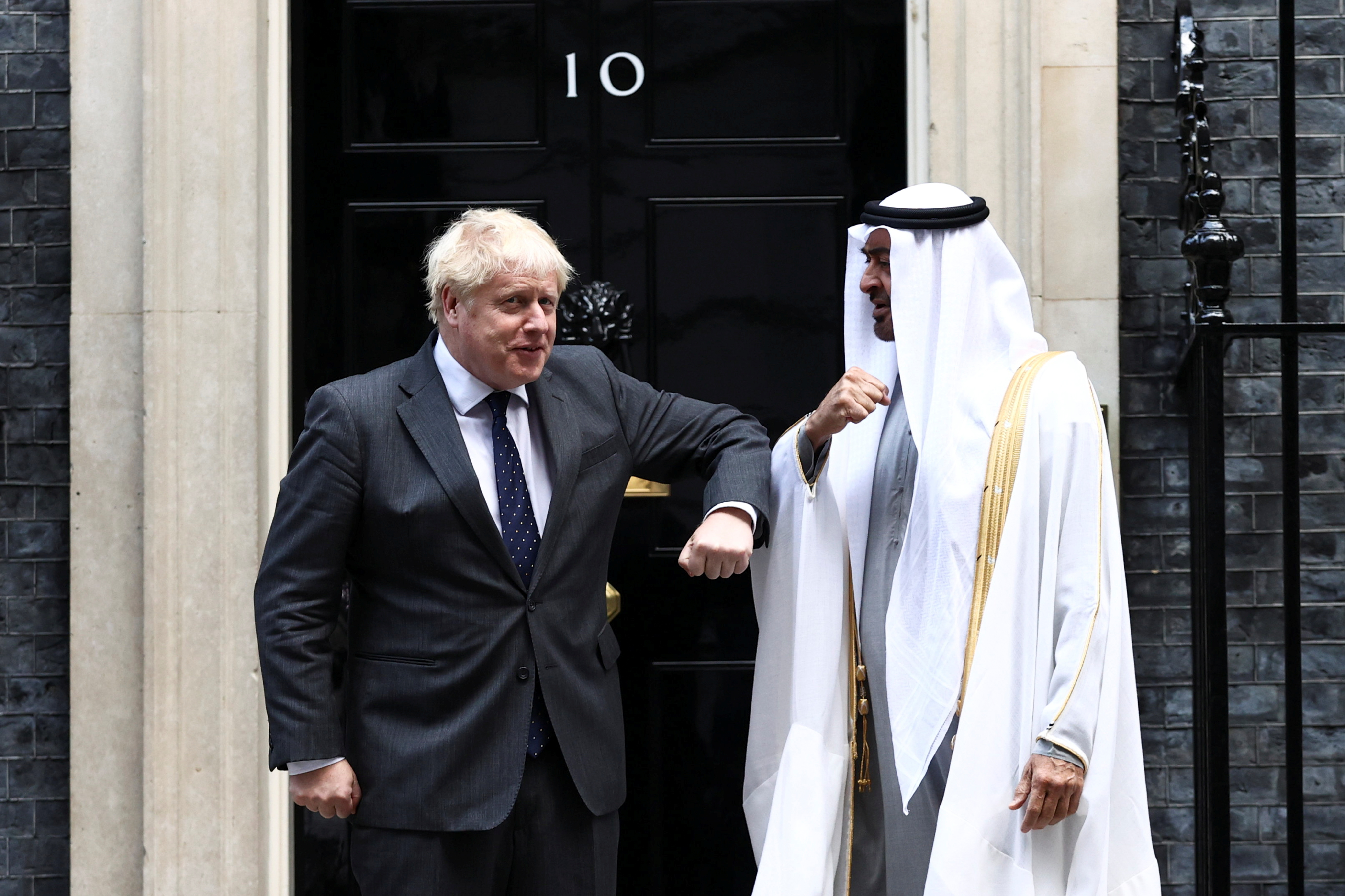 Britain's Prime Minister Boris Johnson welcomes Abu Dhabi's Crown Prince Sheikh Mohammed bin Zayed al-Nahyan as he arrives in Downing Street, London, Britain, September 16, 2021. REUTERS/Hannah McKay