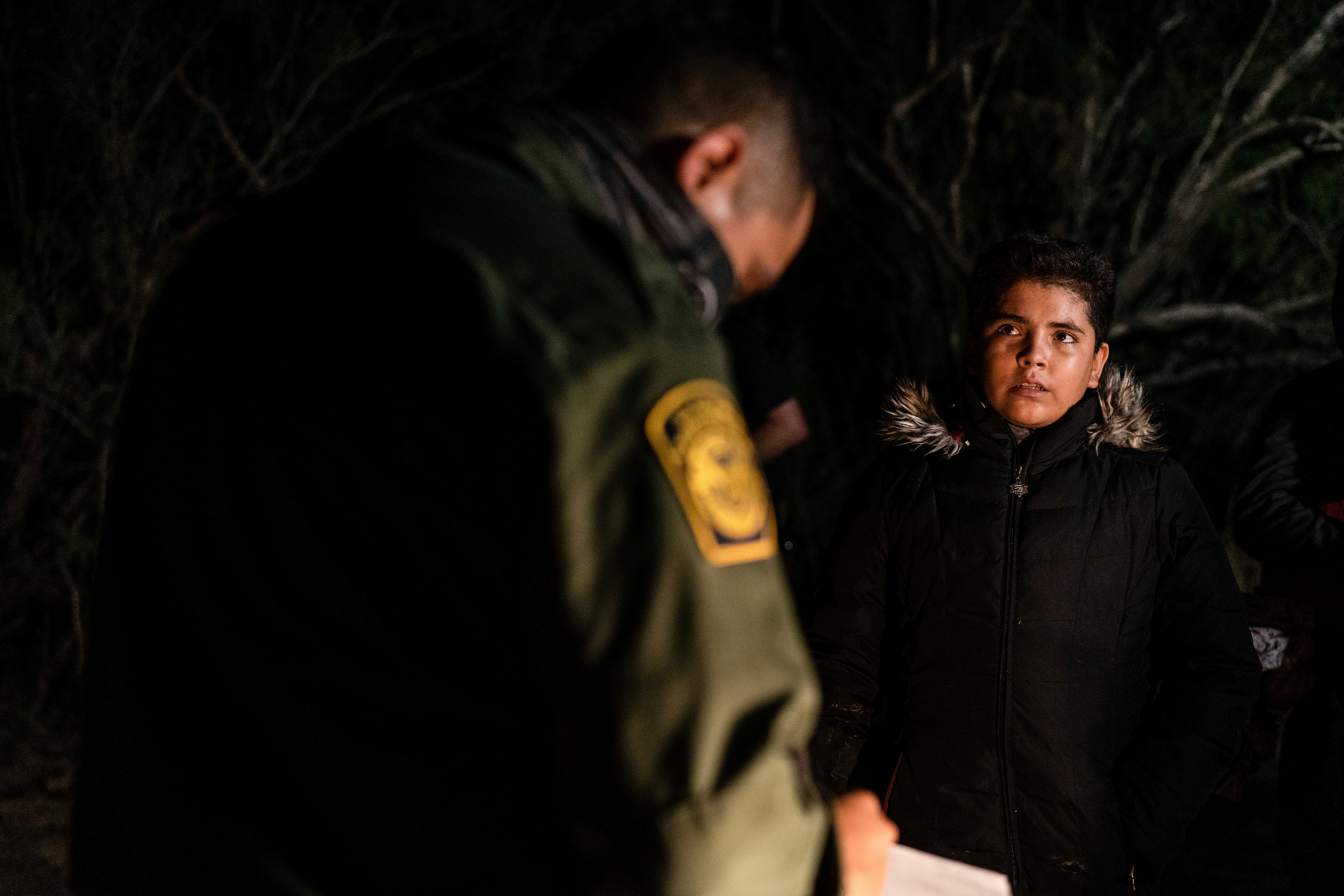 An unaccompanied minor migrant from El Salvador is questioned by the U.S. Border Patrol after crossing the Rio Grande river into the United States from Mexico in Roma, Texas, U.S., April 27, 2021. REUTERS/Go Nakamura