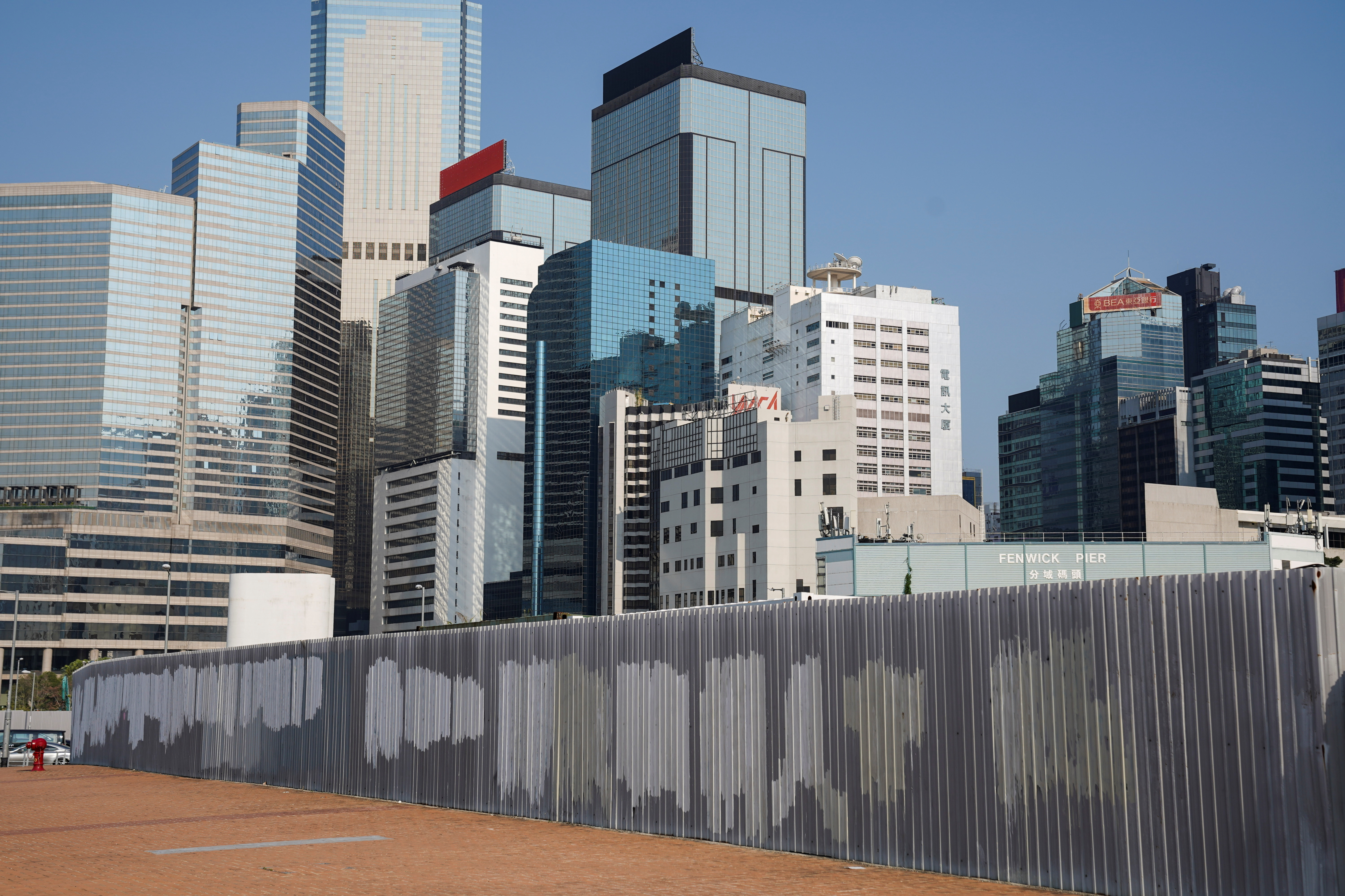 Graffiti has been removed off a fence in Hong Kong's financial district, the site of many 2019 protests, Hong Kong, China, April 23, 2021. REUTERS/Lam Yik