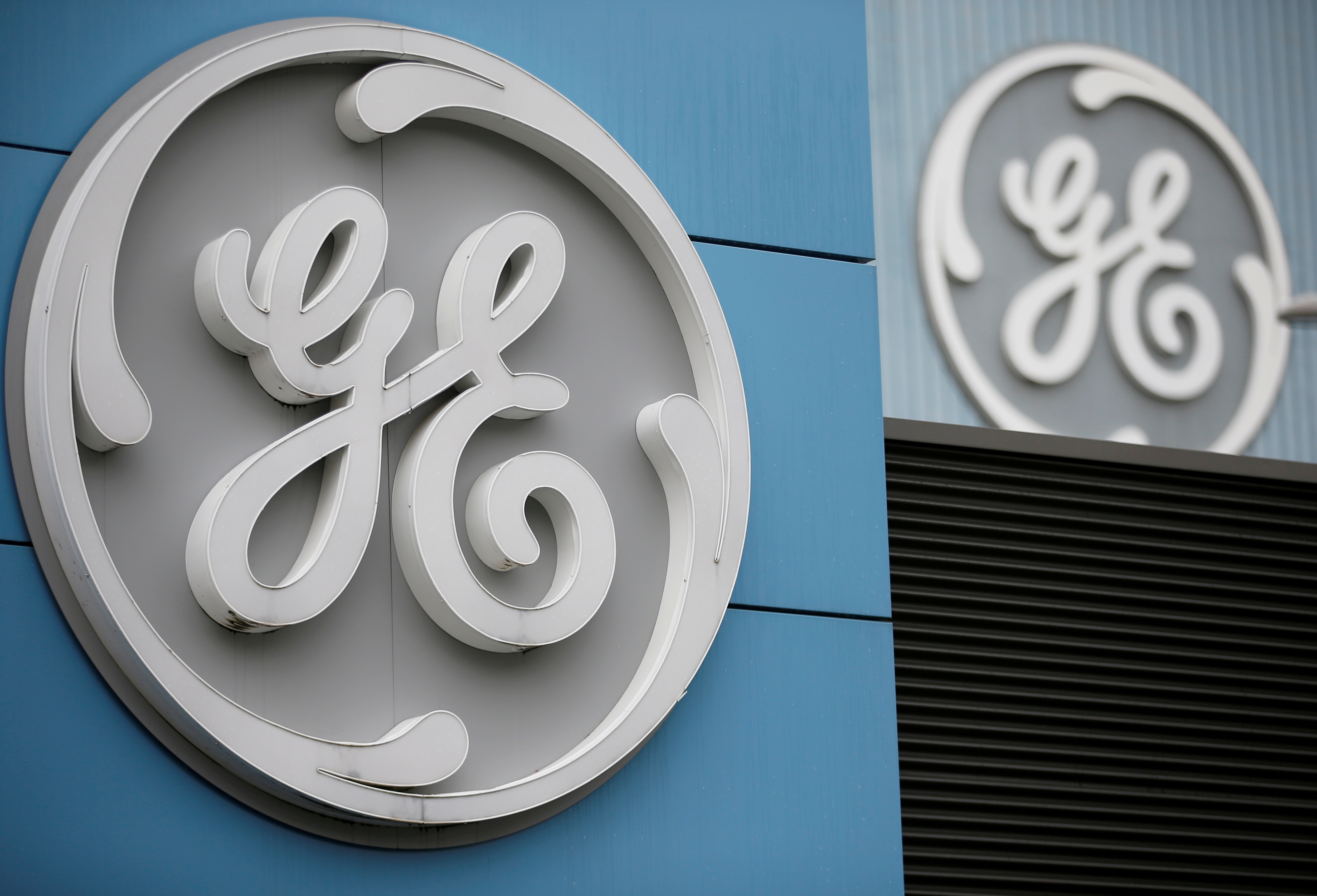 The logo of U.S. conglomerate General Electric is seen on the company building in Belfort, France, October 19, 2019. REUTERS/Vincent Kessler//File Photo